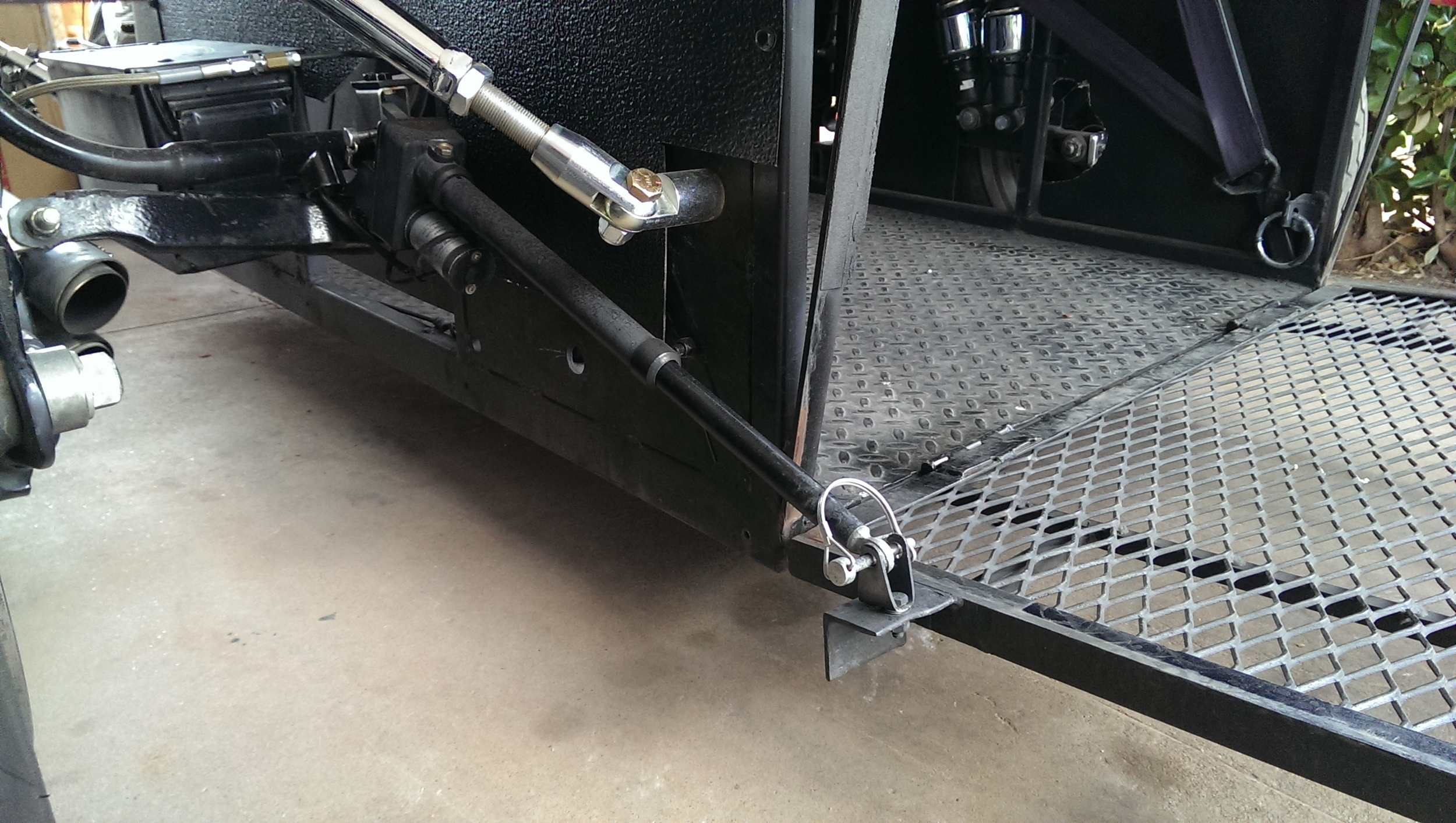 Opening and closing of the lift gate is done using this Linear actuator purchased through  ebay . Removable pins are used to attach the actuator in the event the battery or actuator fail.