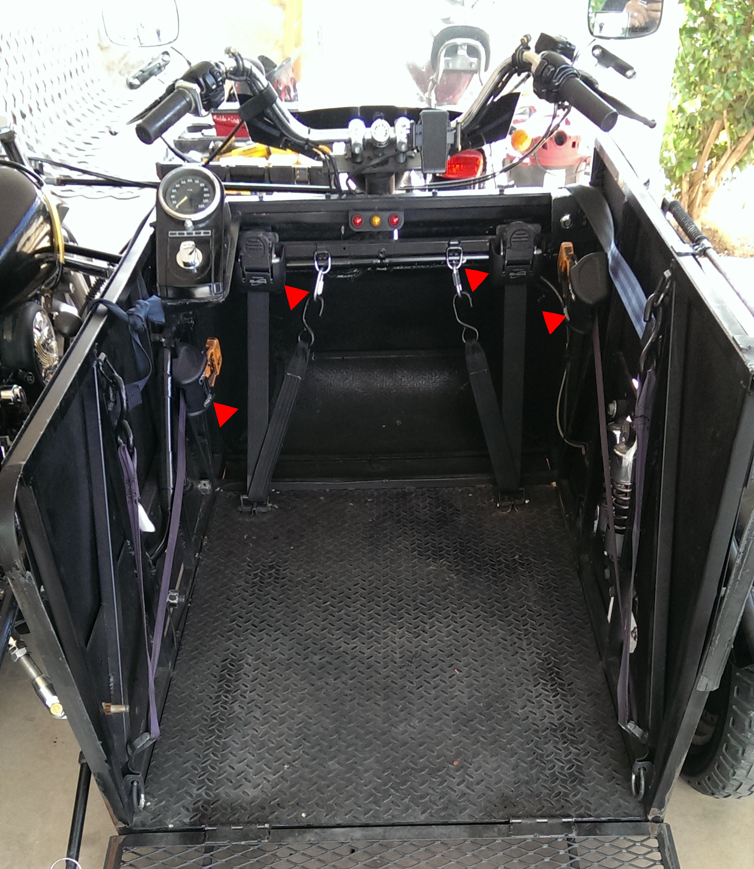 4 ratchet straps purchased from  etrailer.com  are used to secure the wheelchair to the compartment.