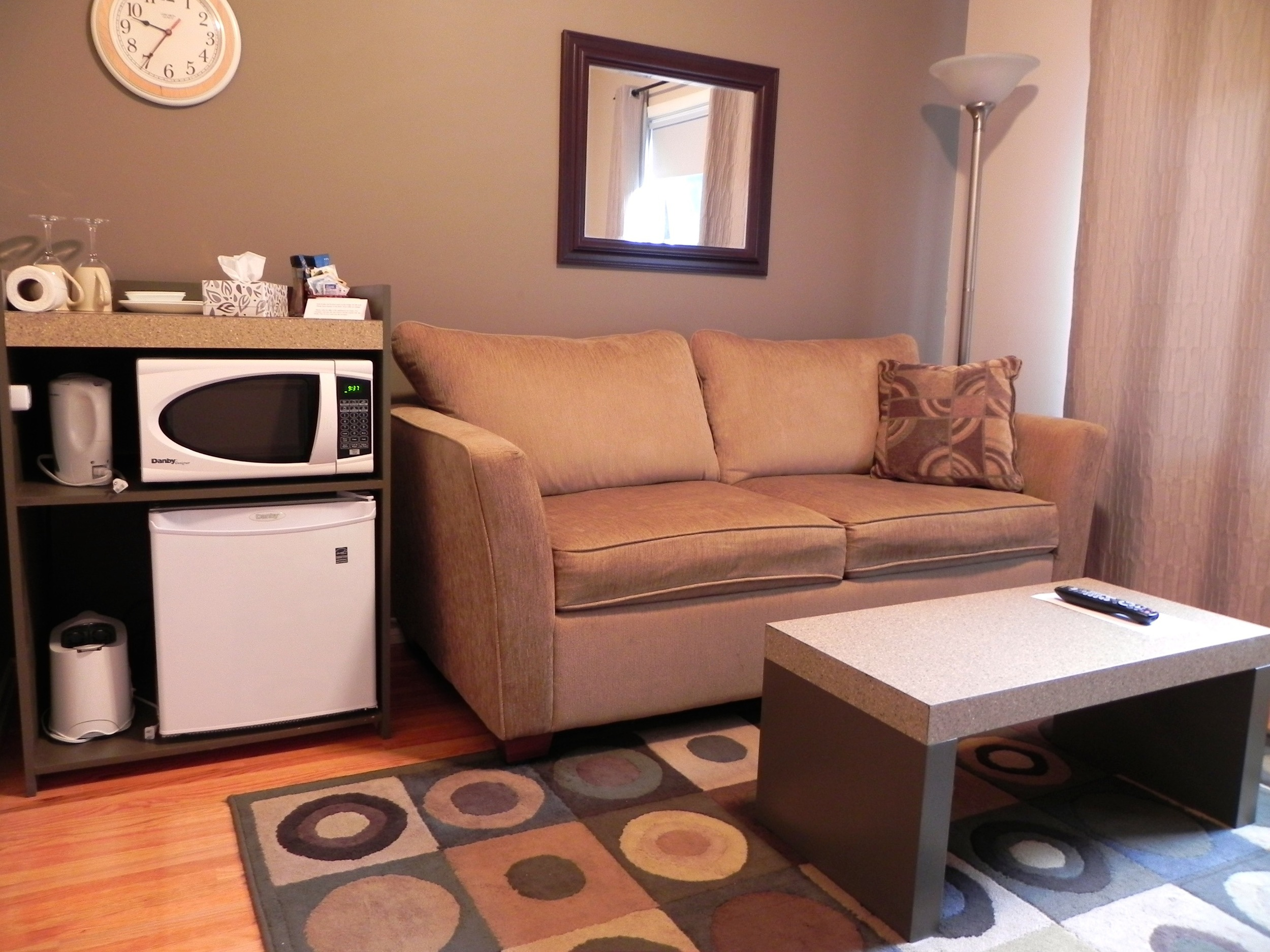 Upper Lounge with Couch and Fridge