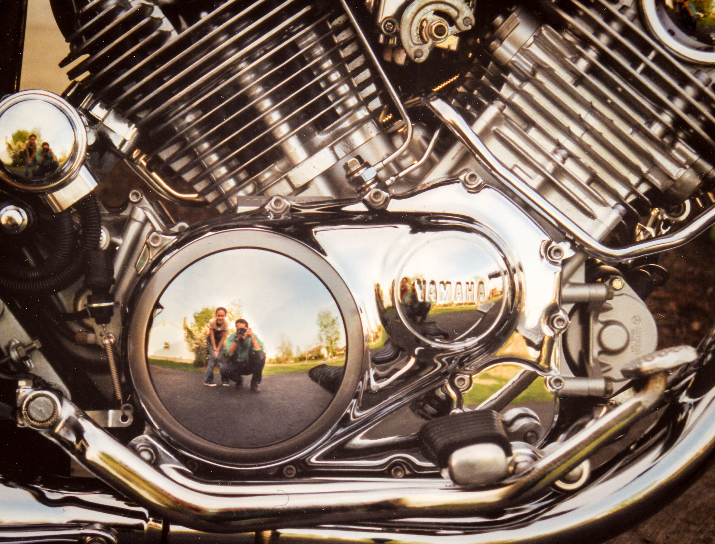 Amy and me reflected in the chromed crankcase of my last Yamaha