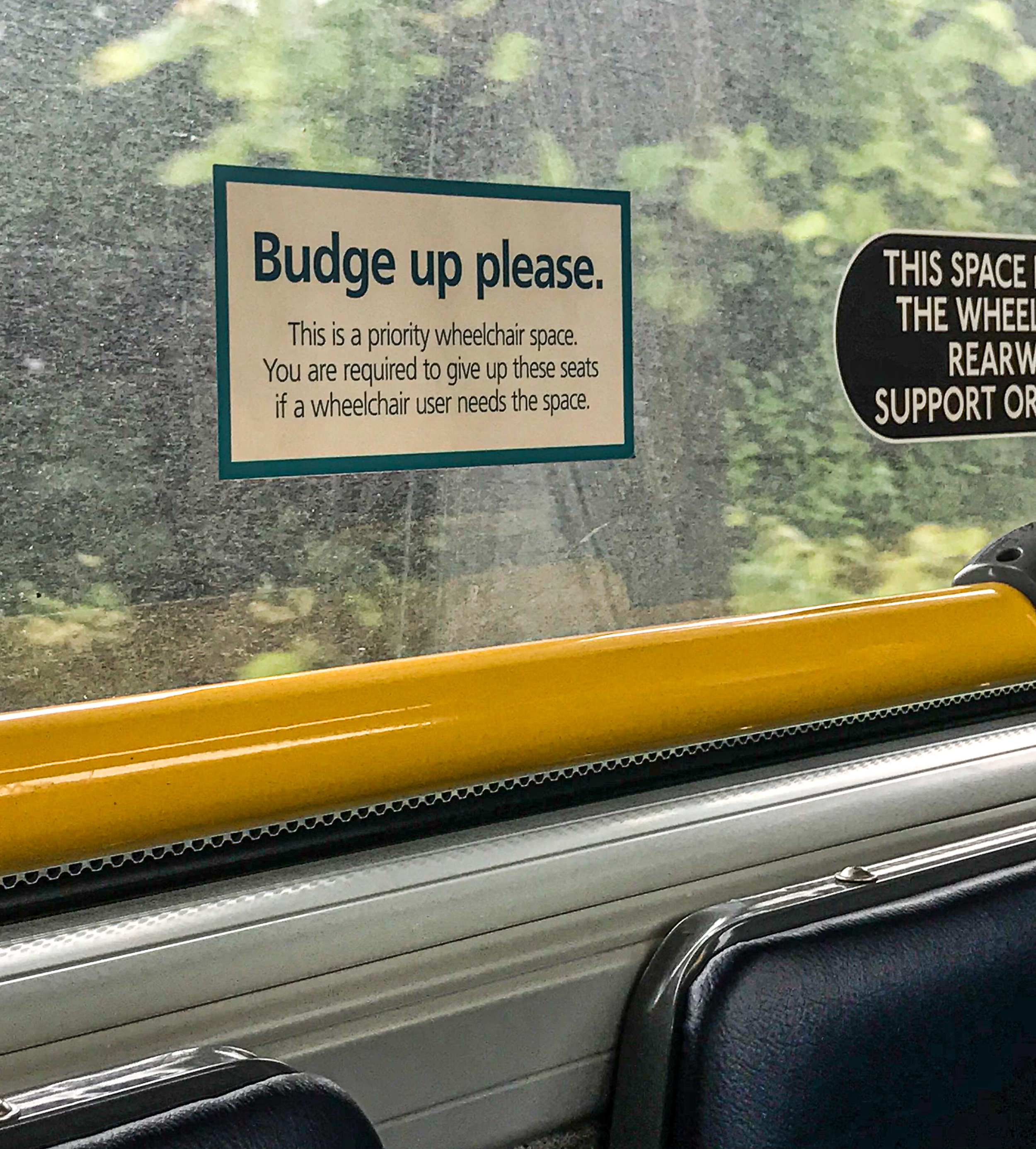 A sign in the bus next to my seat. Gotta luv this Brit-speak!