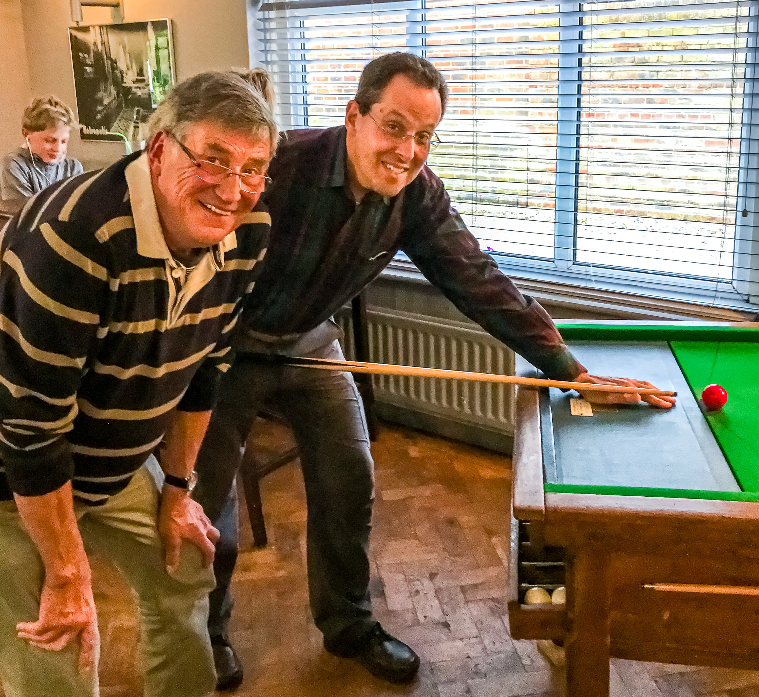 My mate Colin and me playing  Bar Billiards  after dinner at  The Seaview .