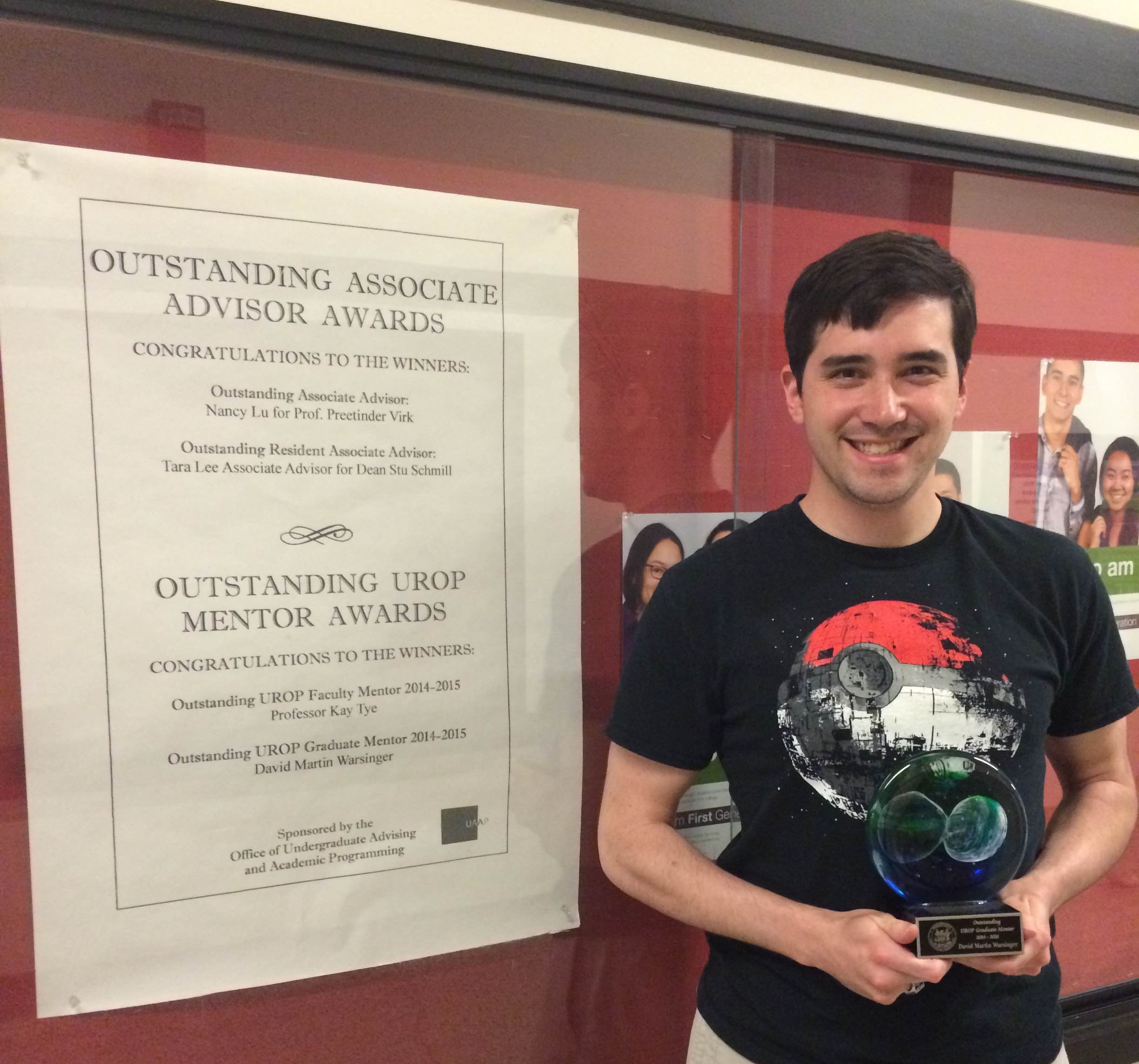 "David, next to the posting in the MIT infinite corridor for the award:  ""Outstanding UROP Graduate Mentor 2014-2015""  while holding the trophy for said award. One was awarded each year among MIT's 6,800 graduate students."