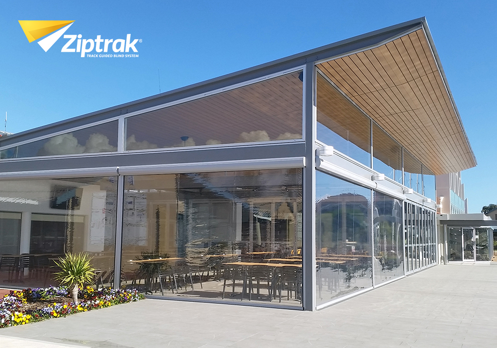 Ziptrak® PVC Blinds - This is a tracked PVC blind that is weather proof and ideal in high-wind areas. The PVC can be tinted or clear, so as not to obstruct the view.