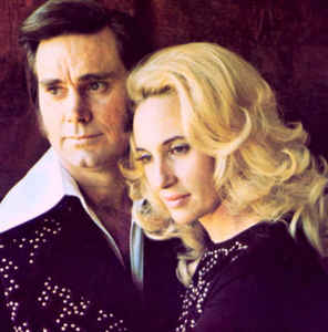 "The royal couple of country music throughout (and even after) their marriage, George Jones and Tammy Wynette had a tumultuous relationship marked by an intense love that was marred by Jones's frequent serious bouts of alcoholism. They had their union play out on the stage and on record as well, where several of their duet album and single releases become C&W chart smashes. Even a divorce in 1976 didn't stop their collaborations entirely. One of their signature hits together is featured on this 2nd episode of S&G's ""California On My Mind"" theme."