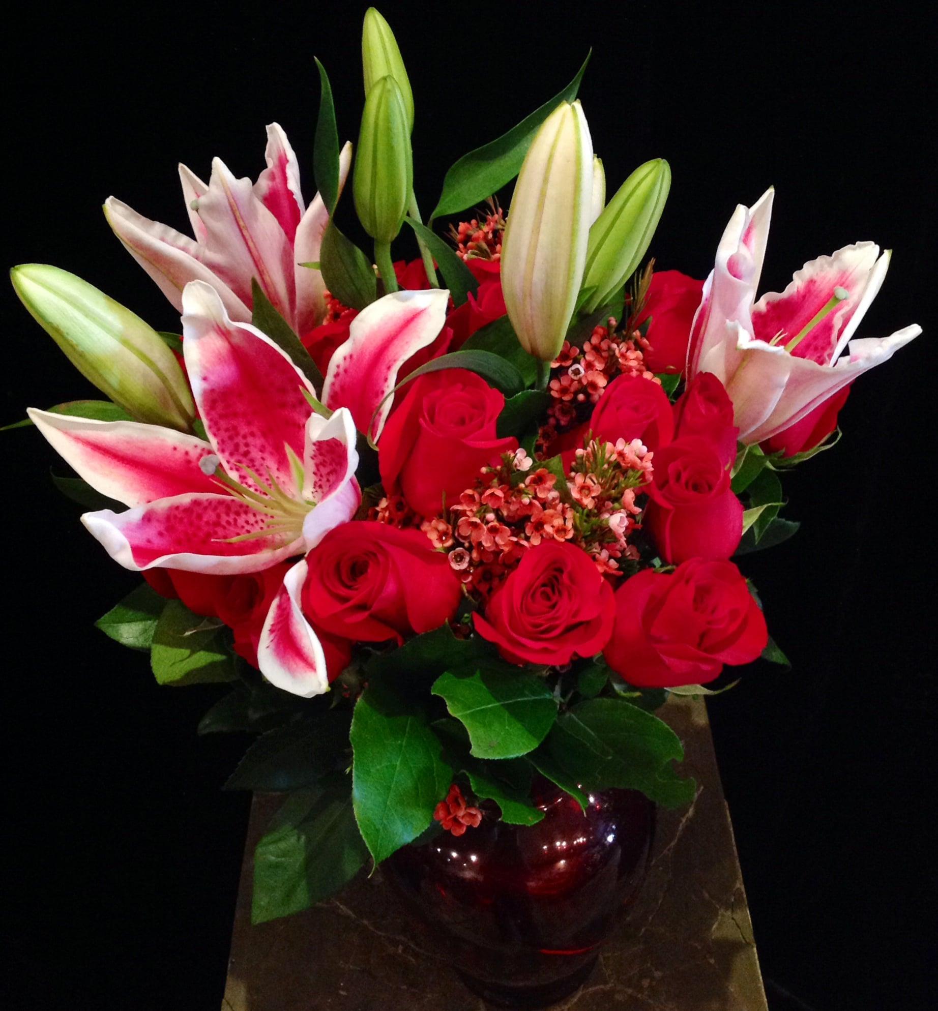 A Dozen Red Roses, Stargazer Lilies, & Waxflower