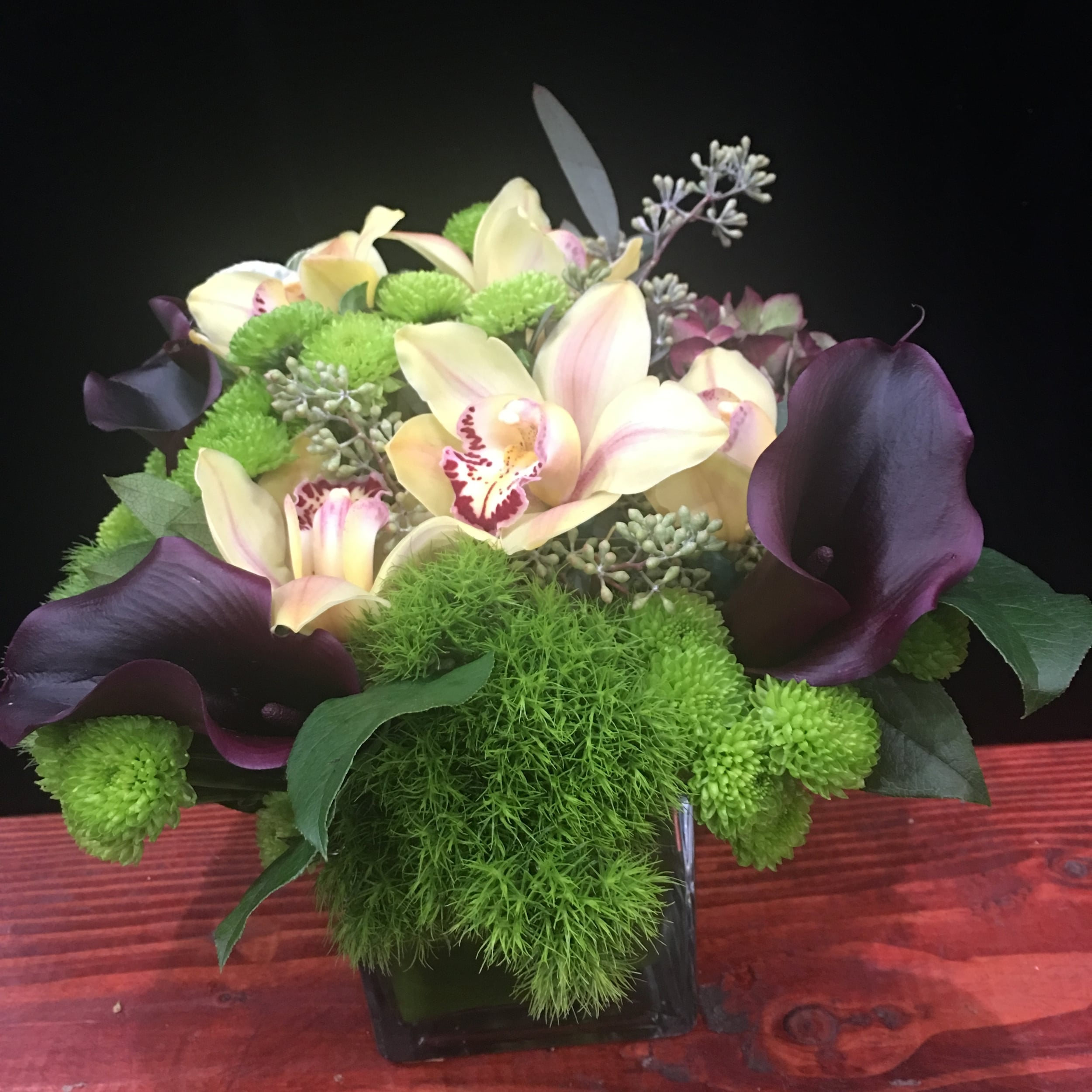 Eggplant Calla Lilies, Green Chrysanthemum, Dianthus, Yellow Cymbidium, touch of Seeded Eucalyptus