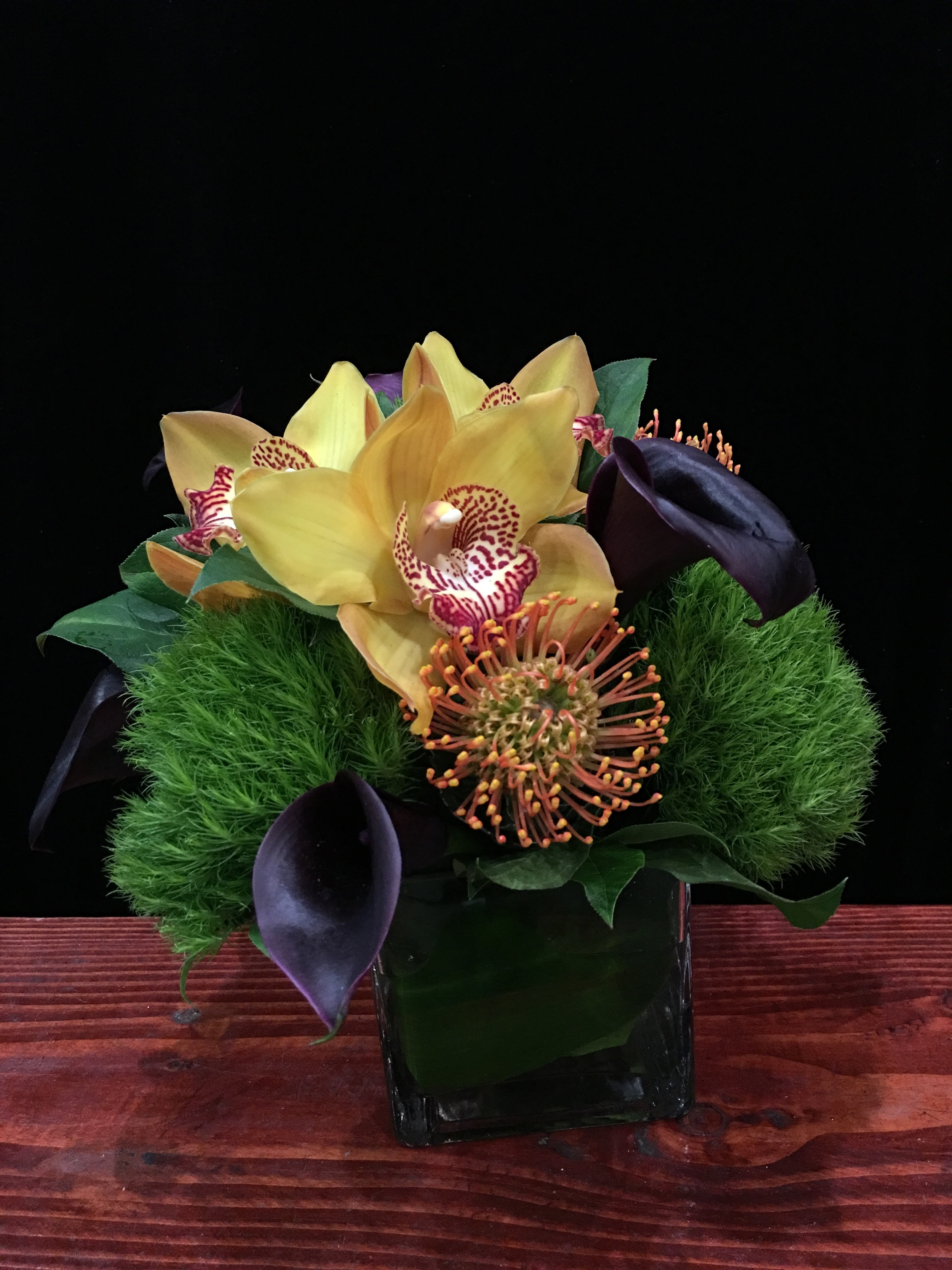 Eggplant Calla Lilies, Orange Pincushion, Yellow Cymbidium Orchids, & Dianthus