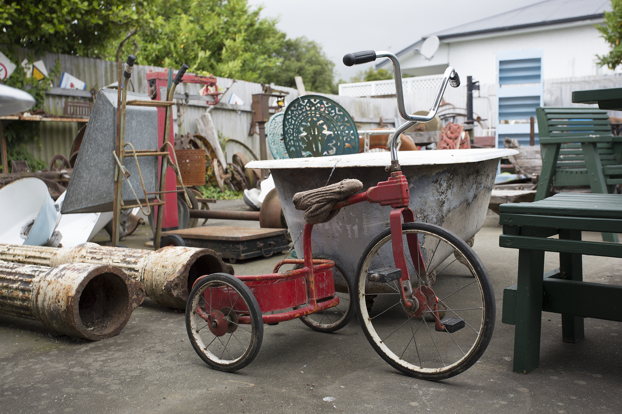 I remember riding a tricycle like this as a little girl at my grandparents orchard, they just don't make things as rough and tough as they used to. This little bike would be well over 30yrs old.