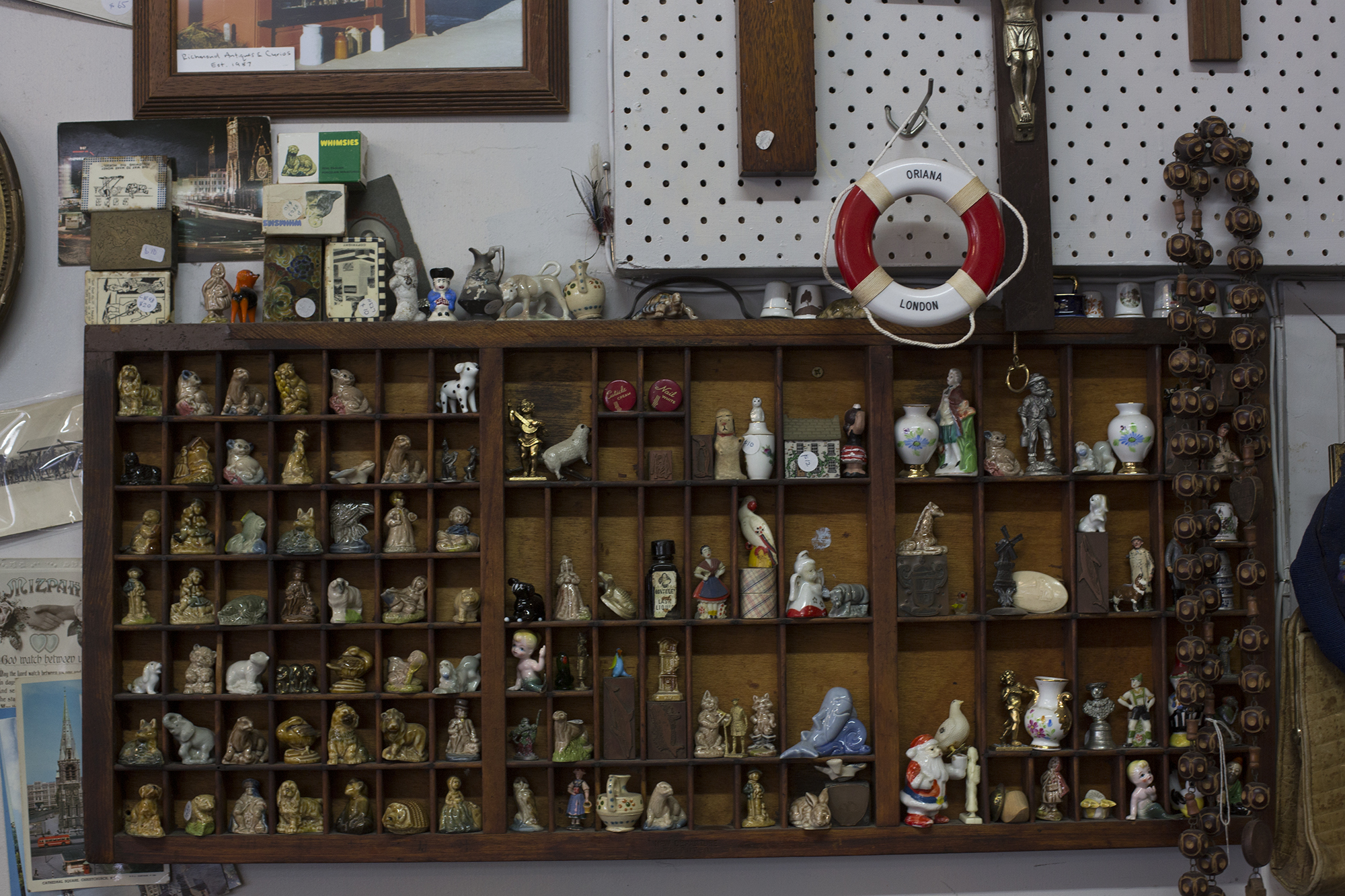 Collections and ornaments, line the walls of the store.