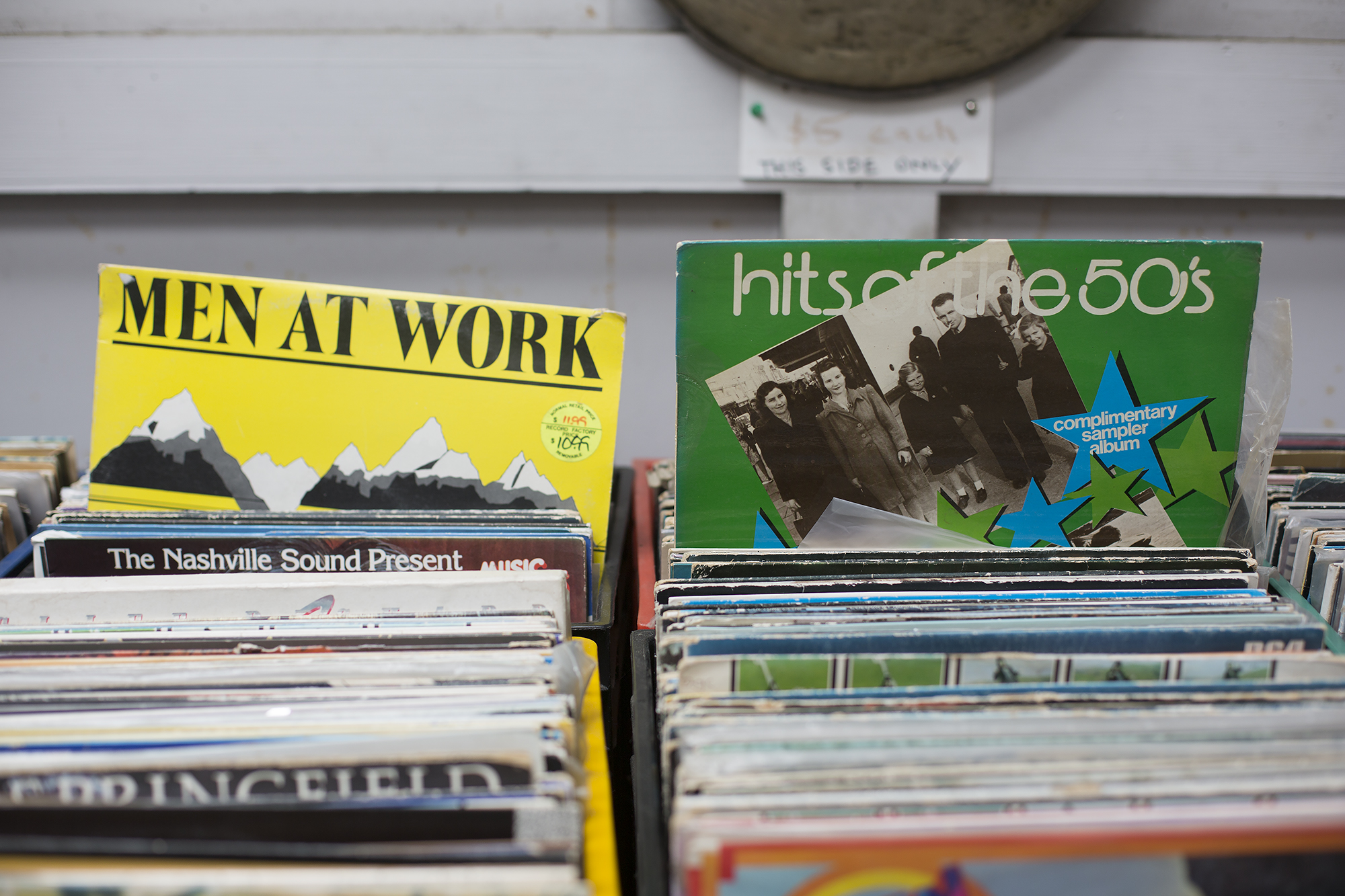 There is an assortment of popular vinyl records out the back, hits of the 1950s & Men At Work on display here.