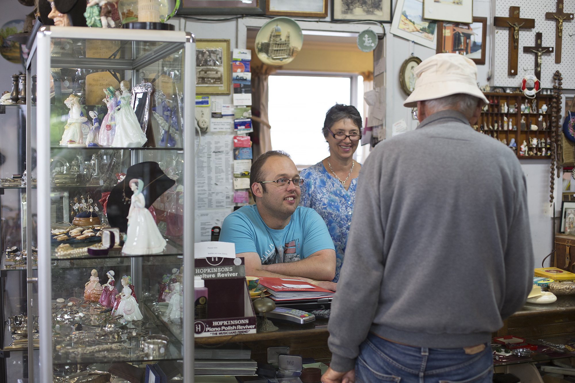 Logan and Maria chat with one of their regular visitors to the store.