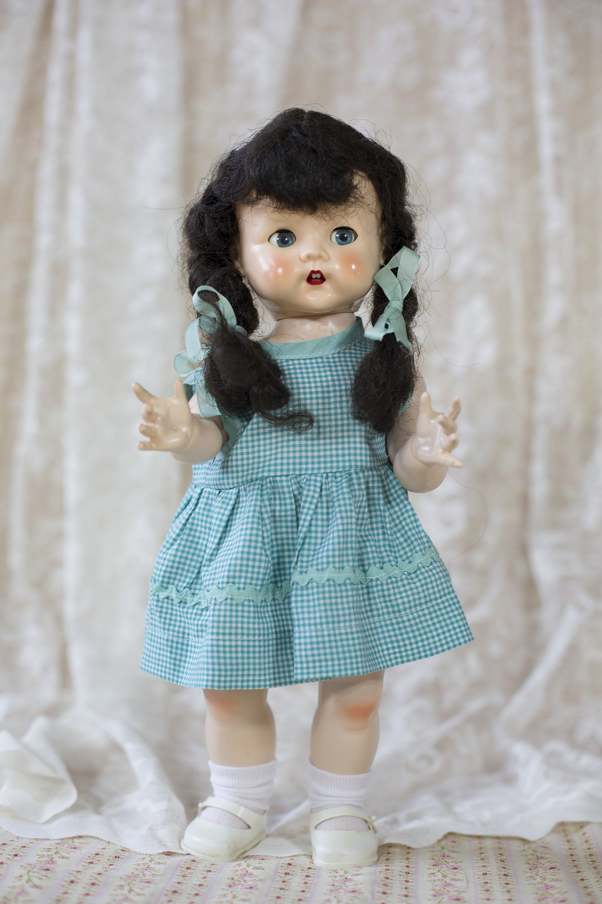 """English pedigree doll 16"""" with open mouth and teeth. In original wig with plaits. Purchased on Trade Me in April 2010."""
