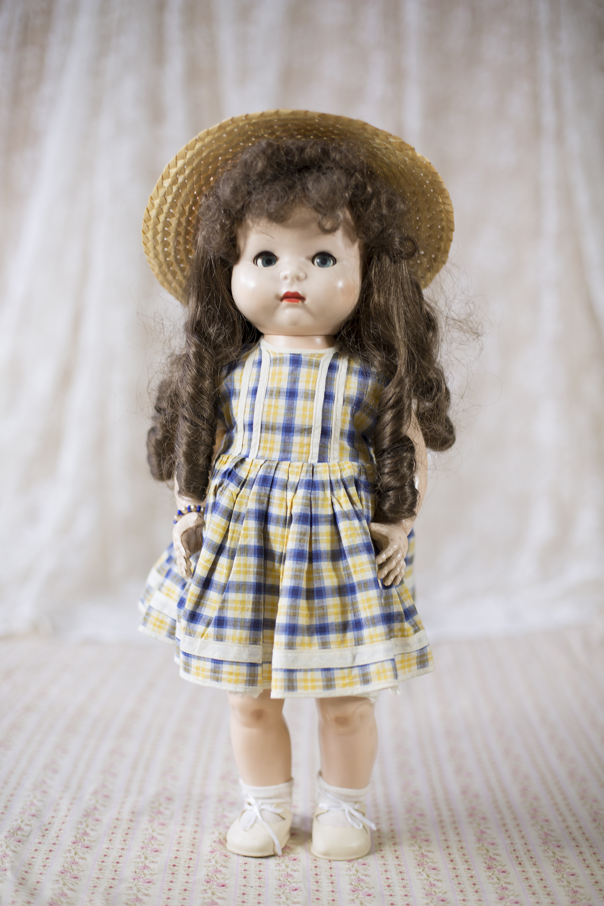 """Judith's """"Walkie Talkie"""" doll from the 1960's, she is still in her original frock with straw hat, shoes and socks. Orginal wig was brown hair in plaits, which has been replaced twice."""