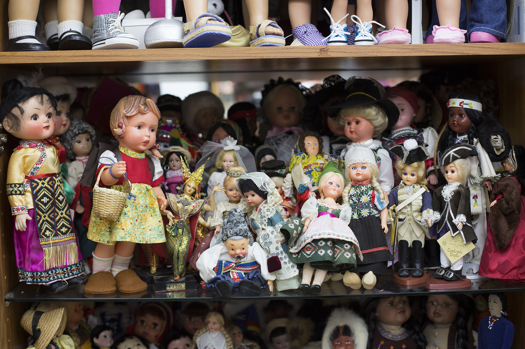 """Judith's national dolls, a collection that began in 1963 when her pen friend's from other countries sent her dolls in national costumes. In the front row is a 1950 12"""" Vinyl M Hummel """"Rosl"""" little school girl by W Eoebel of Germany."""