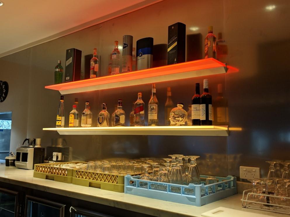 Floating bar shelves with illuminated edging gives maximum impact