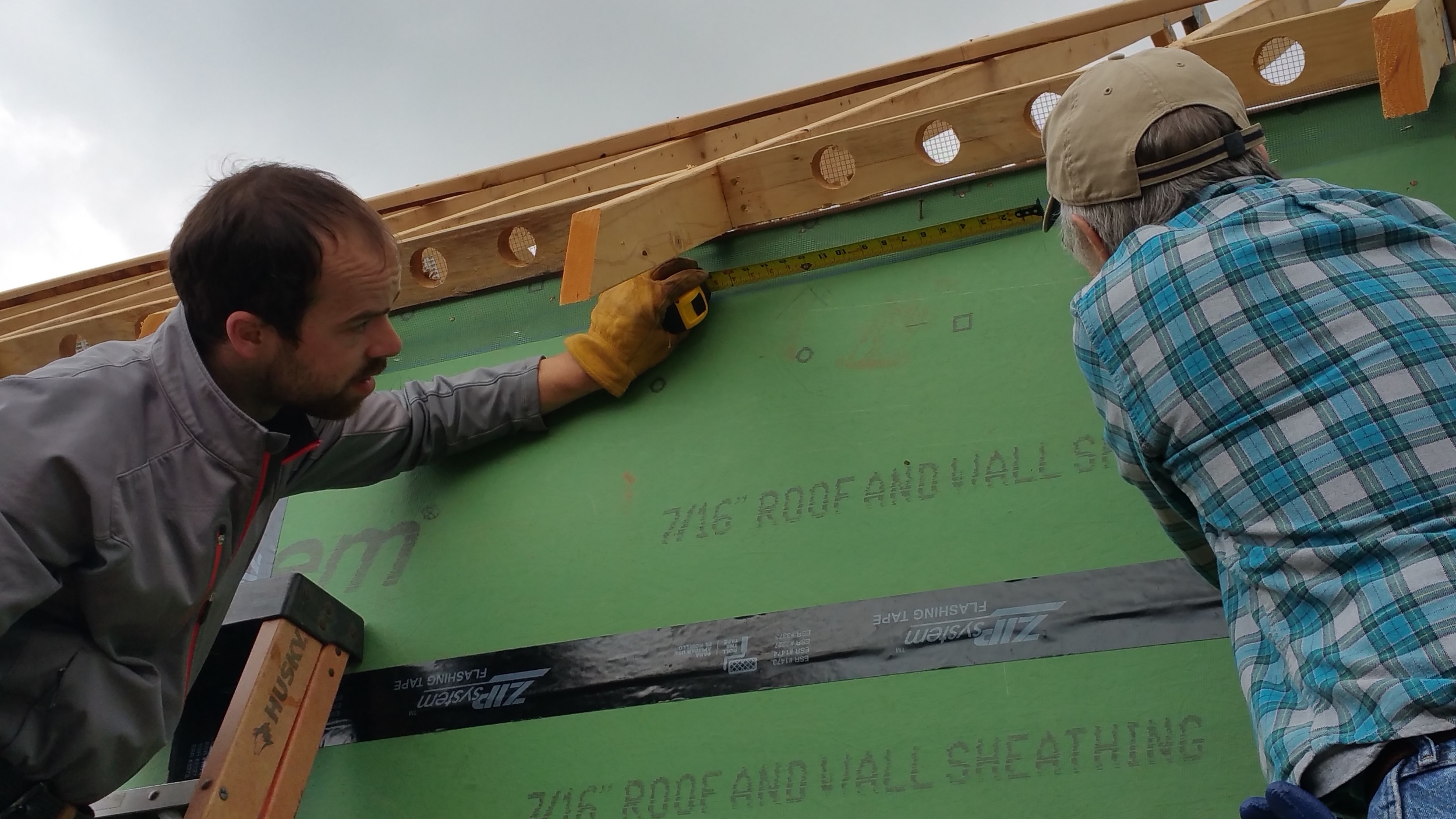 Our Technician Stephen (L) and our photographer Jim Smith (R) installing a bug screen for the upper portion of the rain screen, which was also installed on the bottom of the wall.