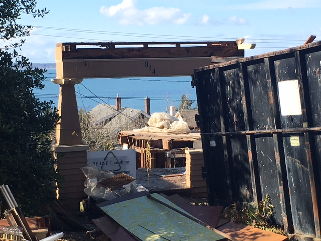 Making way for the new.  An old craftsman residence is being disassembled on site to recycle and salvage materials.