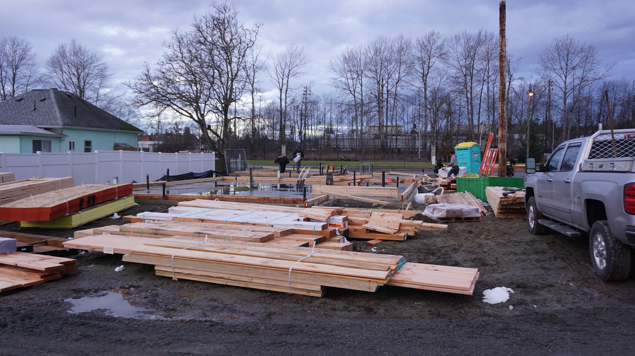 Lumber arriving on site, ready for framing
