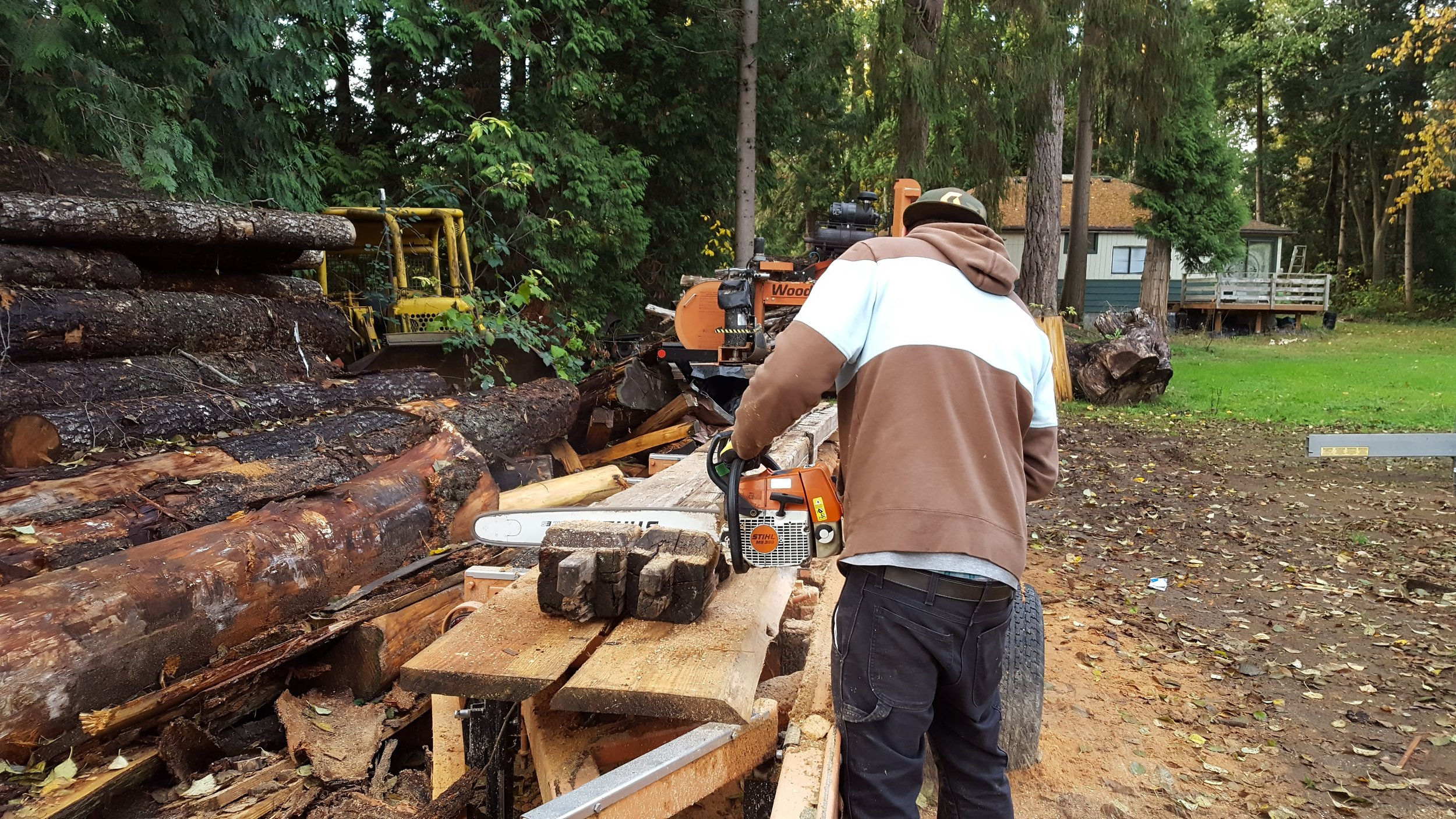 Csaba wielding the stihl like a scalpel. See more of his work @  Northwest Reclaimed
