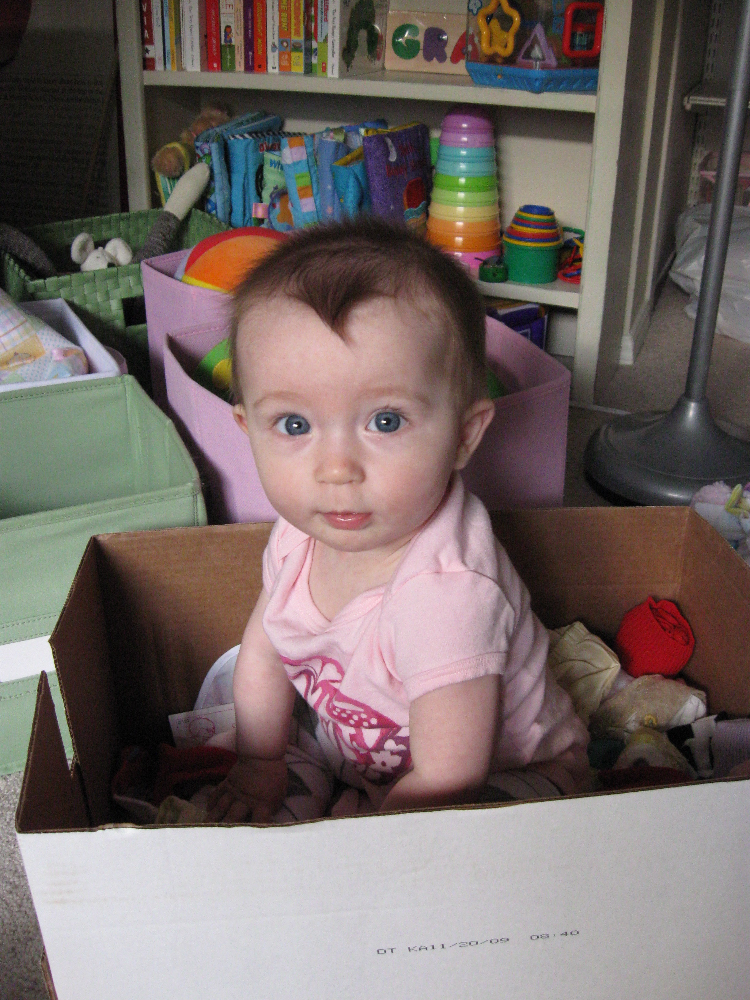 2010—7-month-old Grace helping us unpack, in the bedroom we are currently packing up again