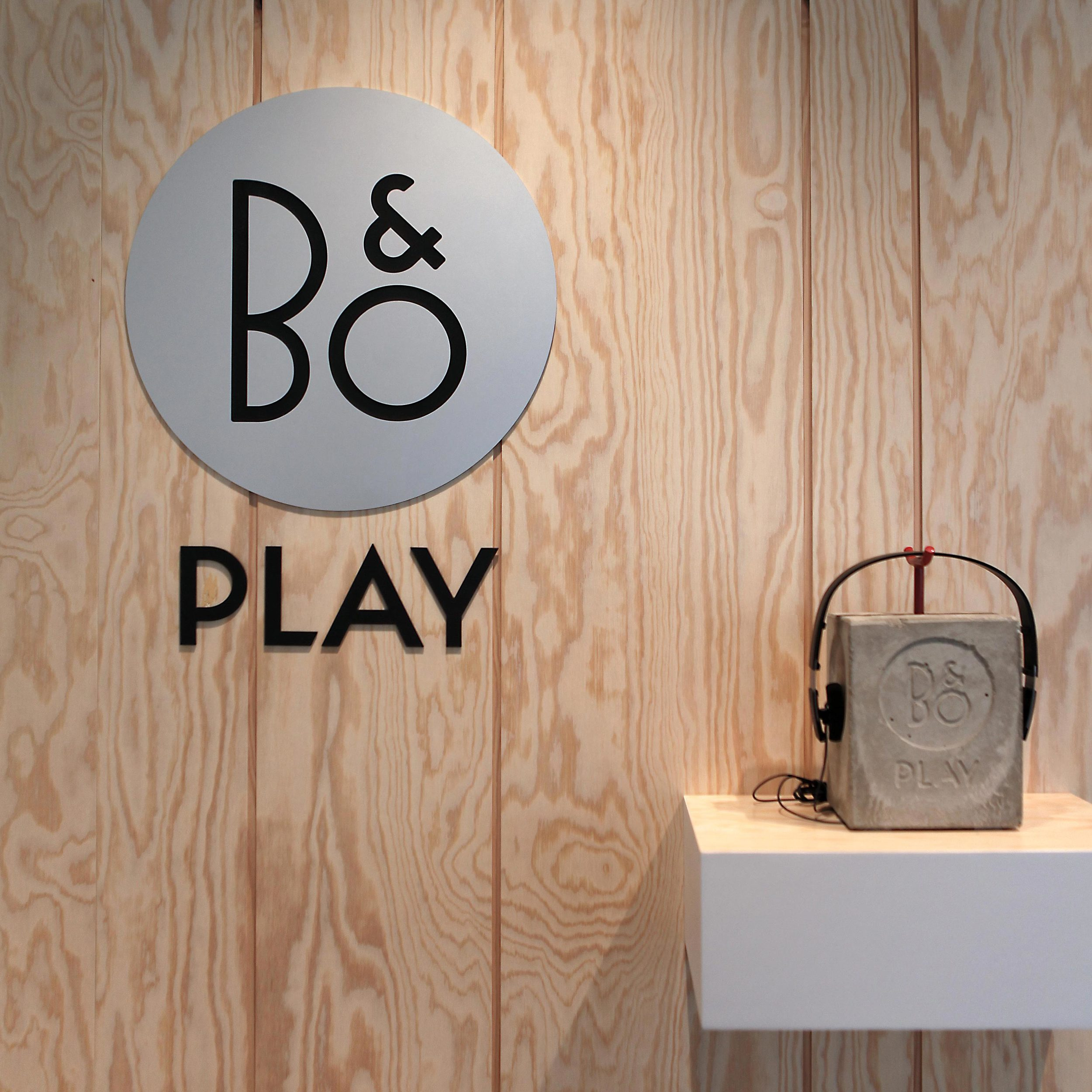 Logo B&O Play mounted to wooden wall at the shop