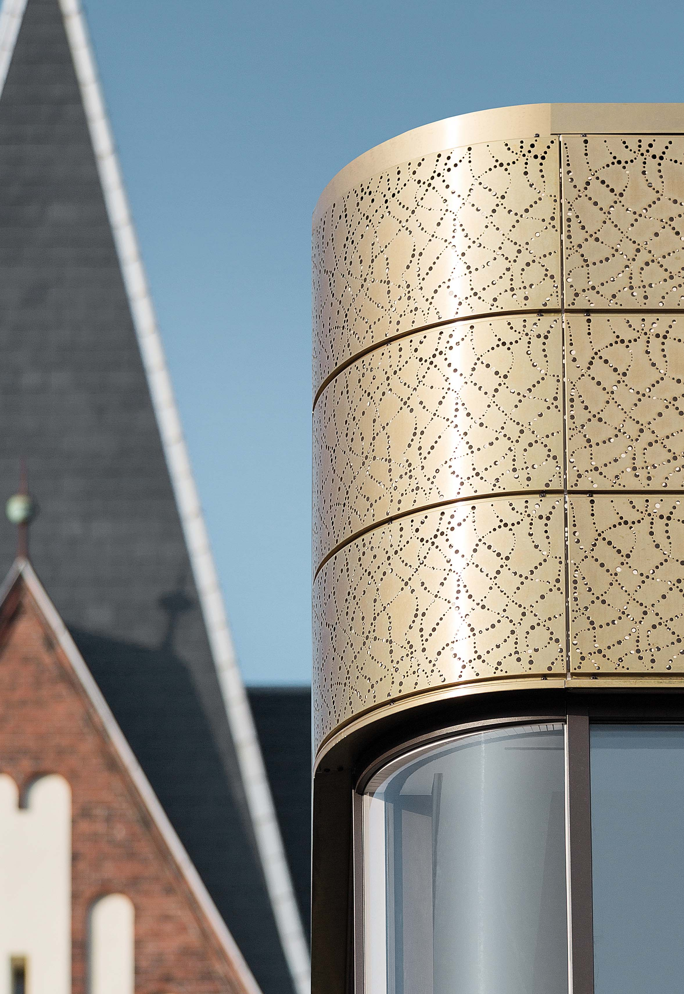 Detail of brass facade in daylight, iconic part of the flagship store of Bang & Olufsen located in Herning