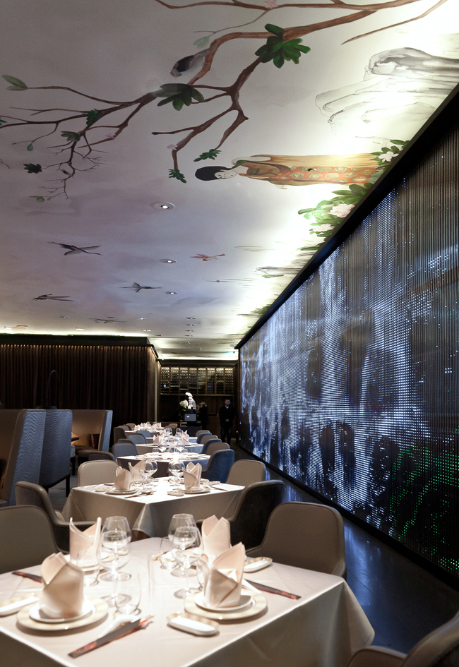 LED curtain showcasing a waterfall juxtaposed with an expansive hand-painted artwork inspired by Chinese culture as part of the restaurant design concept for South Beauty Taipei