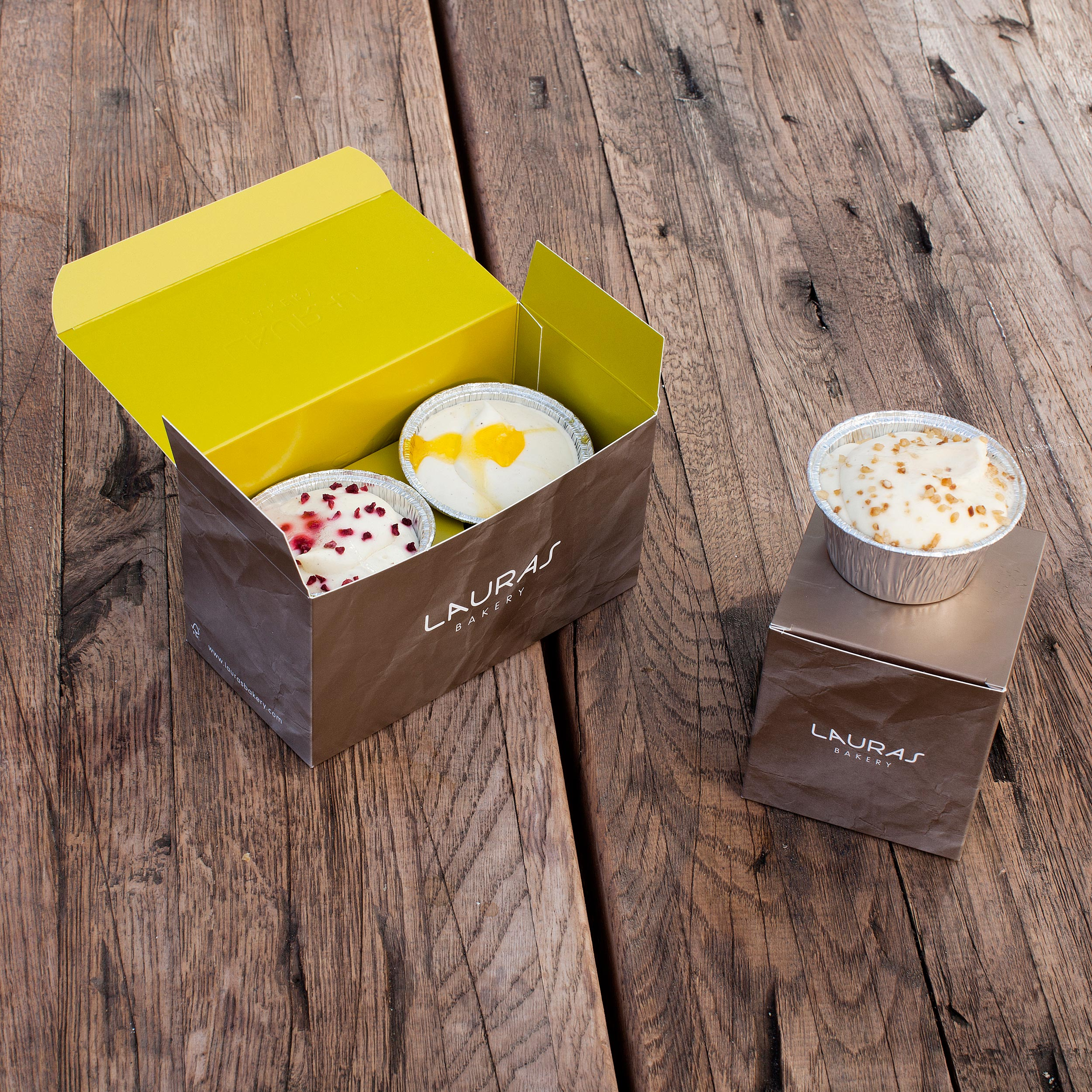 Boxes painted in bright colours on the inside  to enhance the exciting moment of opening a box filled with pastry