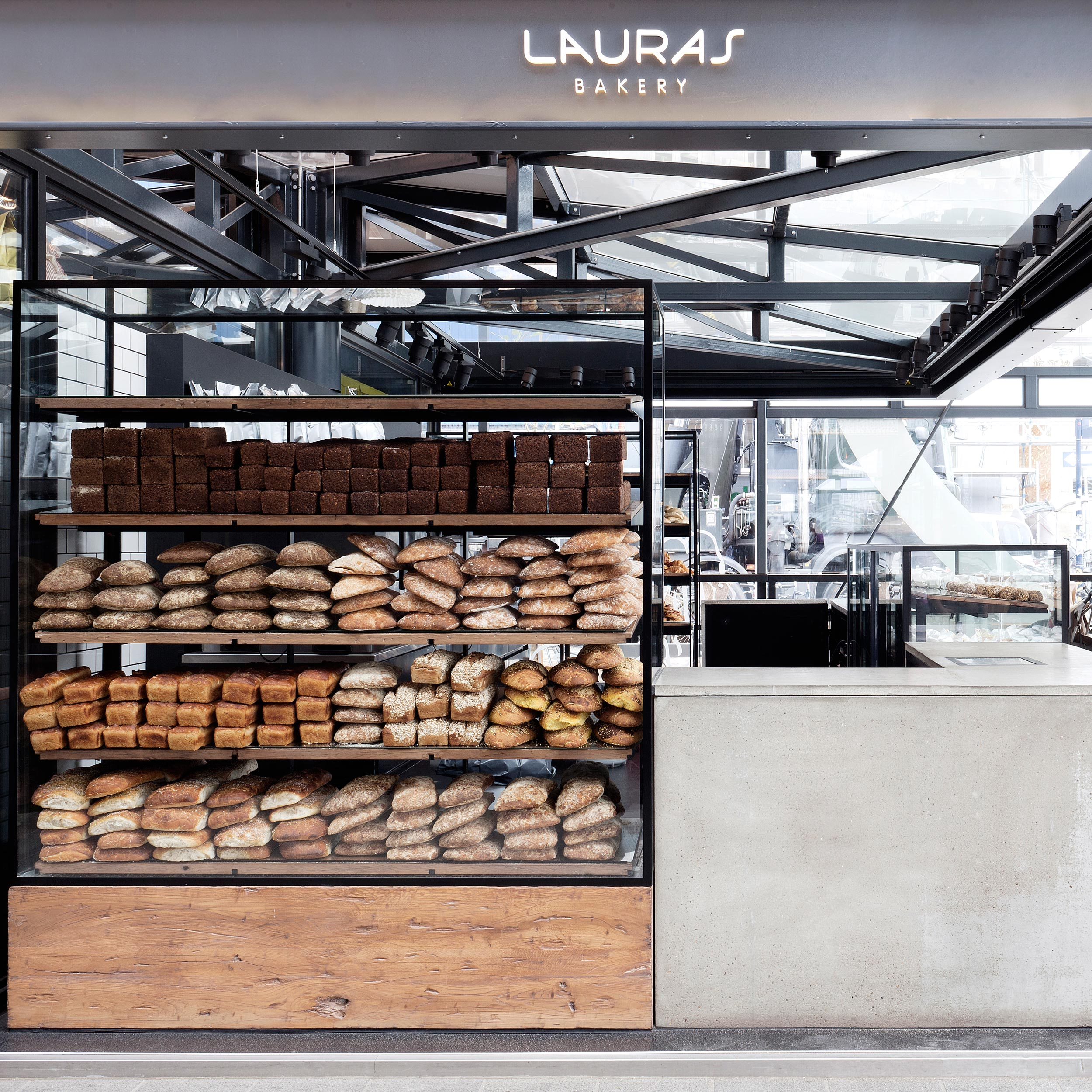 Design of the store interiors of Danish bakery Lauras including custom-designed shelves to display the products