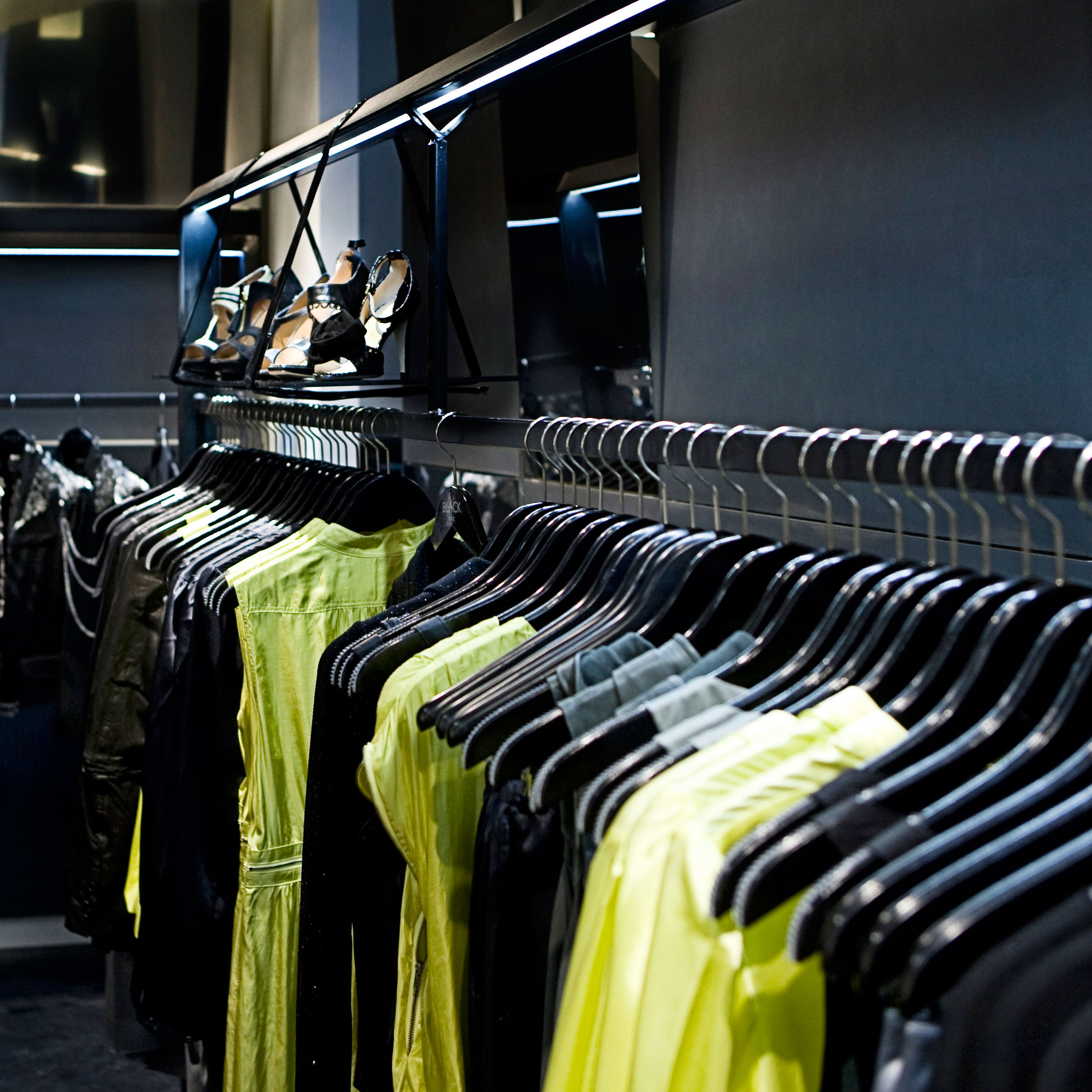 Garments hanging on a rail in a Bllack Noir store