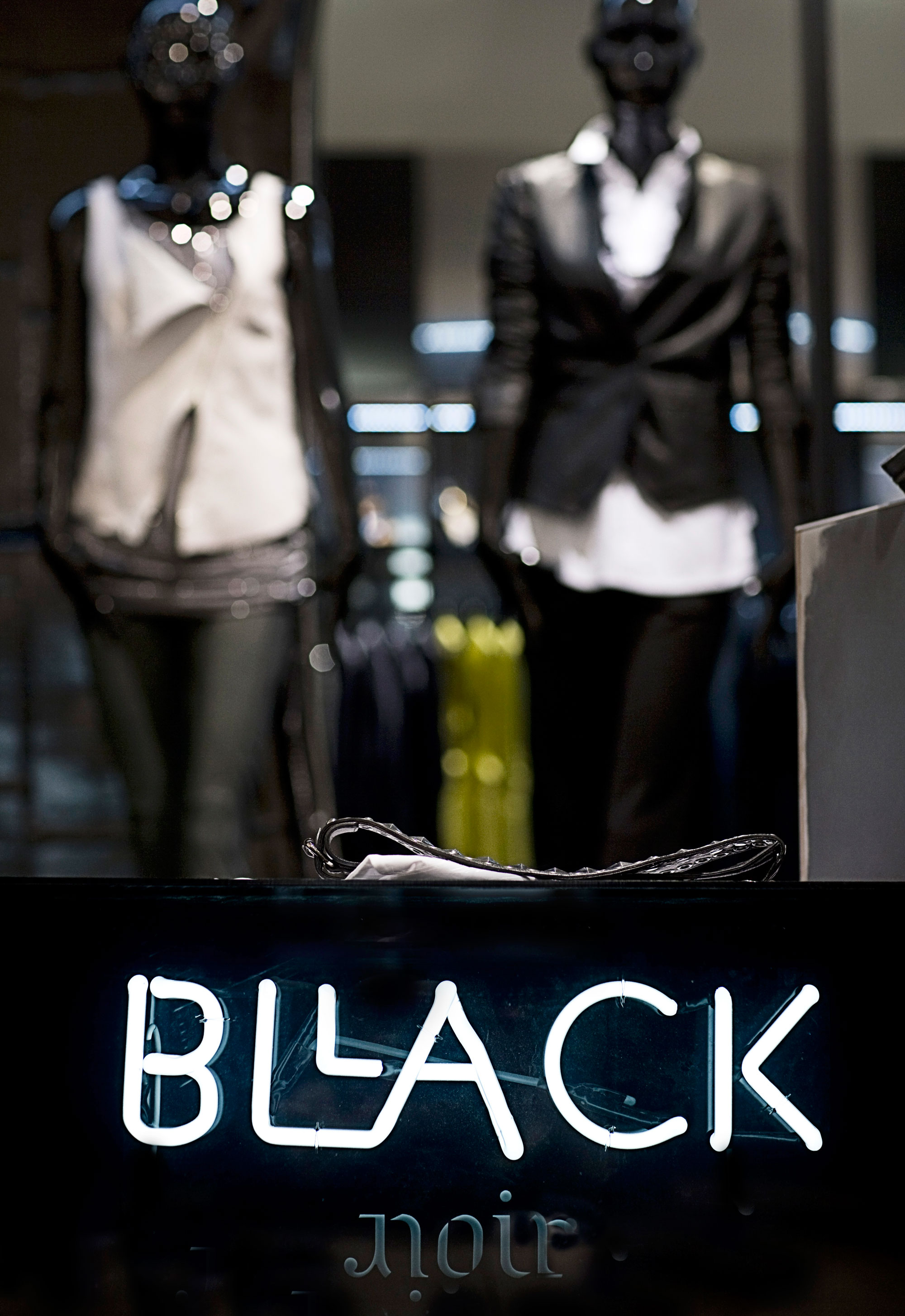 Logo of Bllack Noir with detail of the store´s retail design in the back