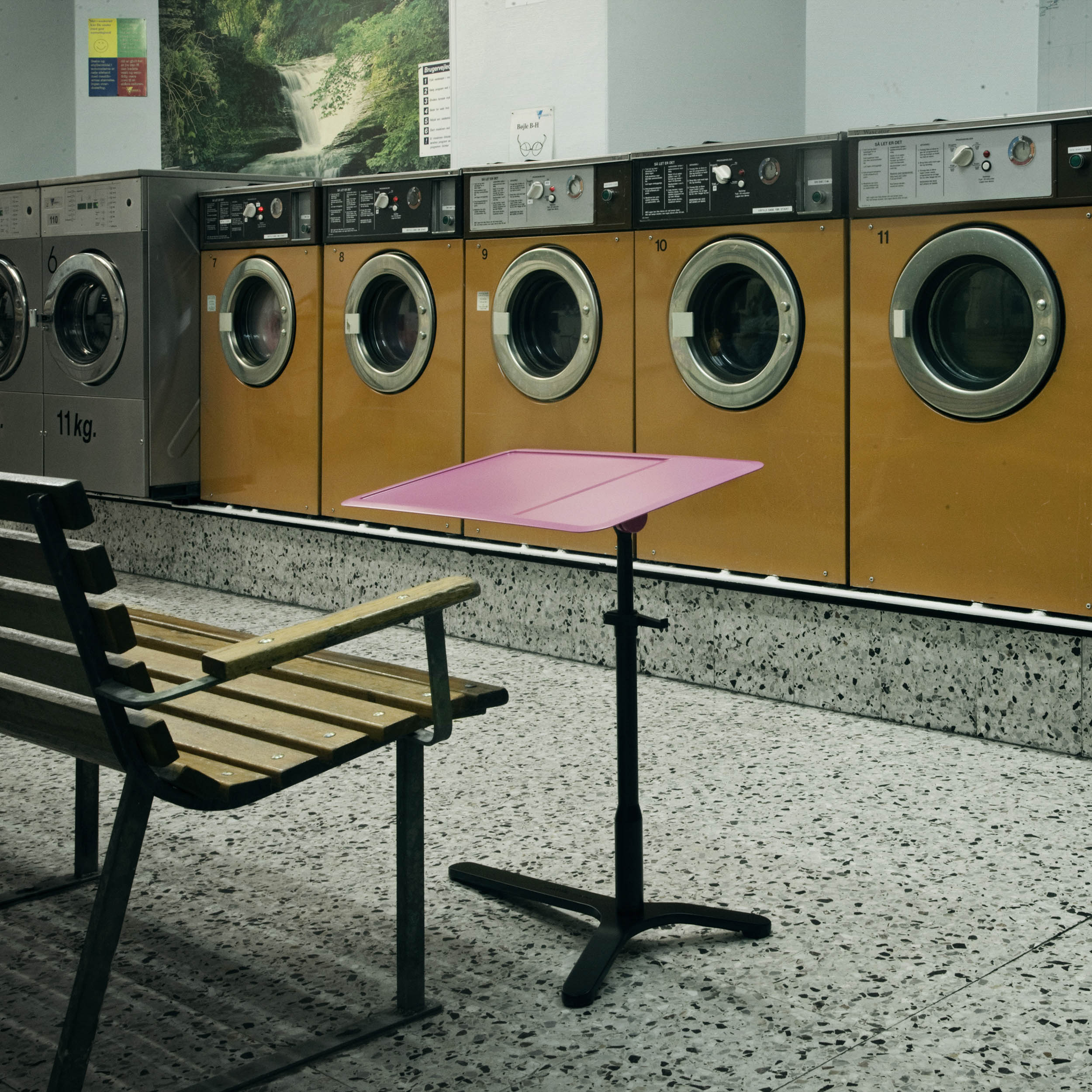 Pink table 'Space Enabler' displayed in a Laundromat