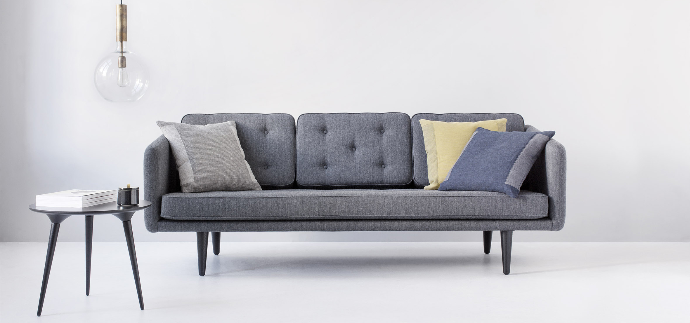 Home interiors with design couch by Fredericia furniture and pillows by Johannes Torpe Studios