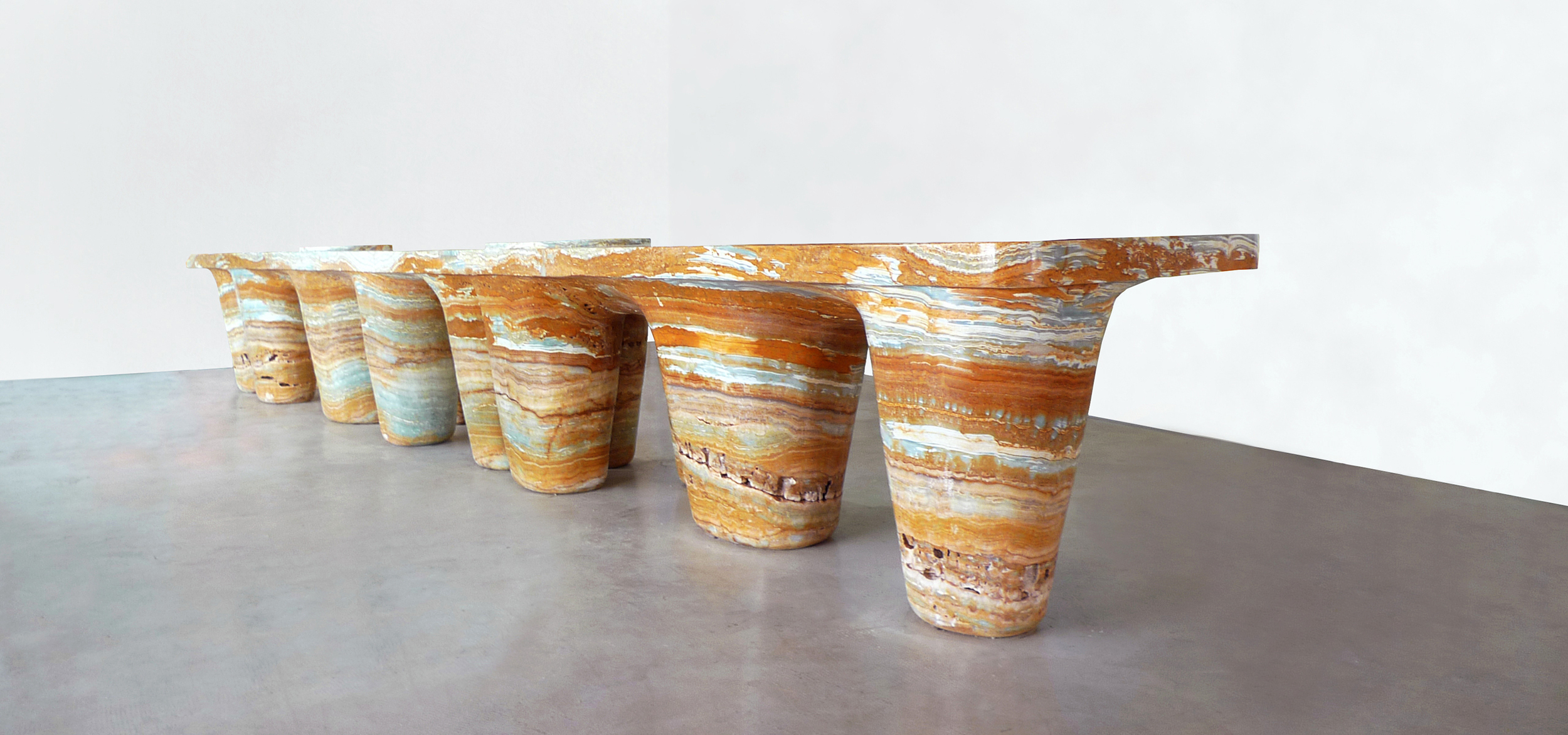 Table made of orange onyx stone created for an art exhibition by interior and furniture designer Johannes Torpe