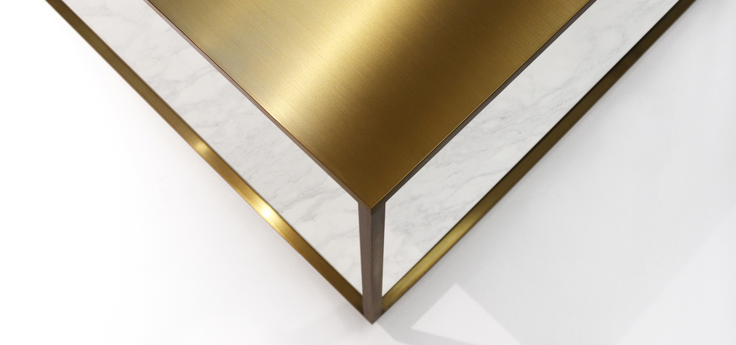 Top view on the Cubic Table made of brass, marble and wood designed by Johannes Torpe as part of a furniture collection for B&O stores