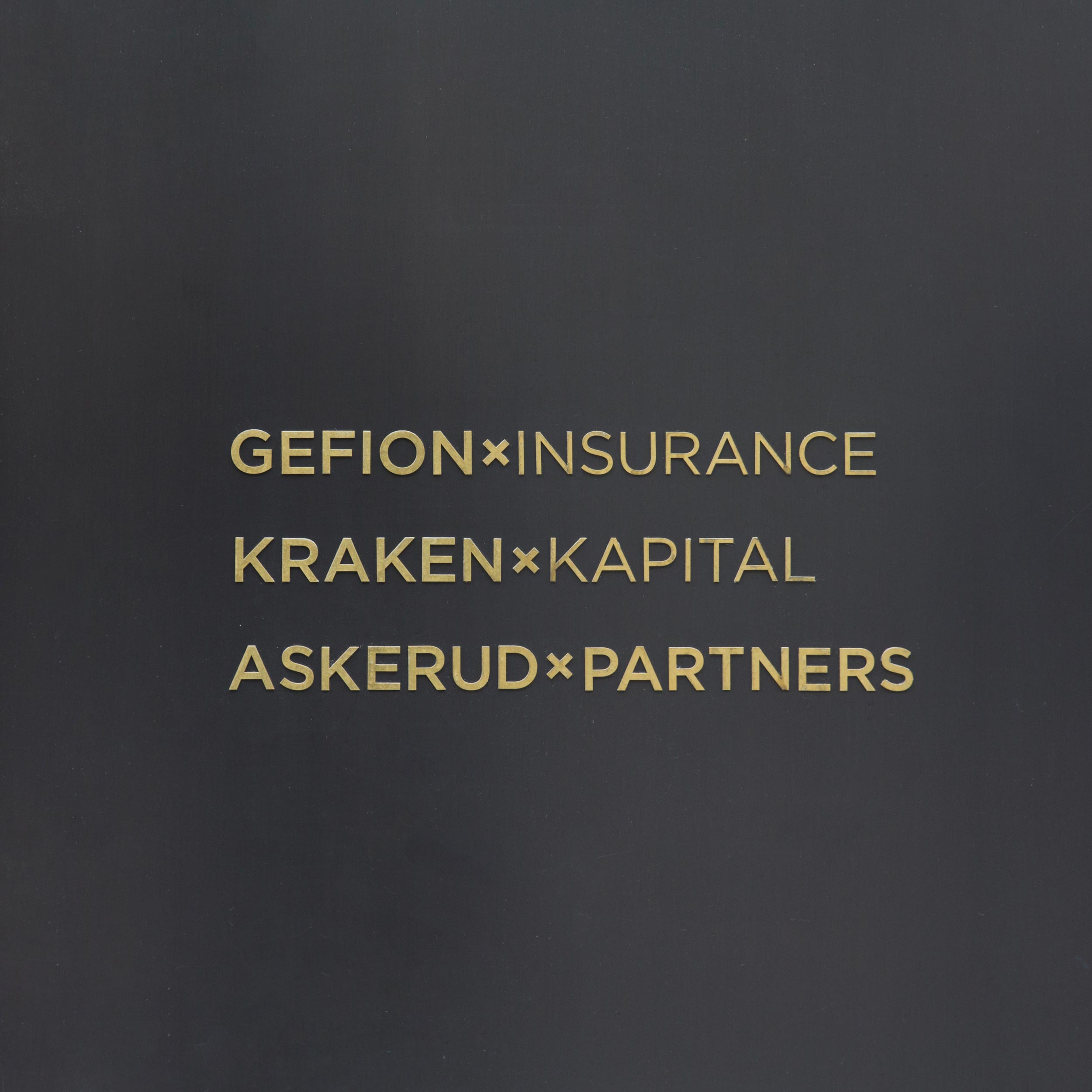 Company names of Gefion Insurance, Kraken Kapital and Askerud Partners mounted to the entrance door of the office