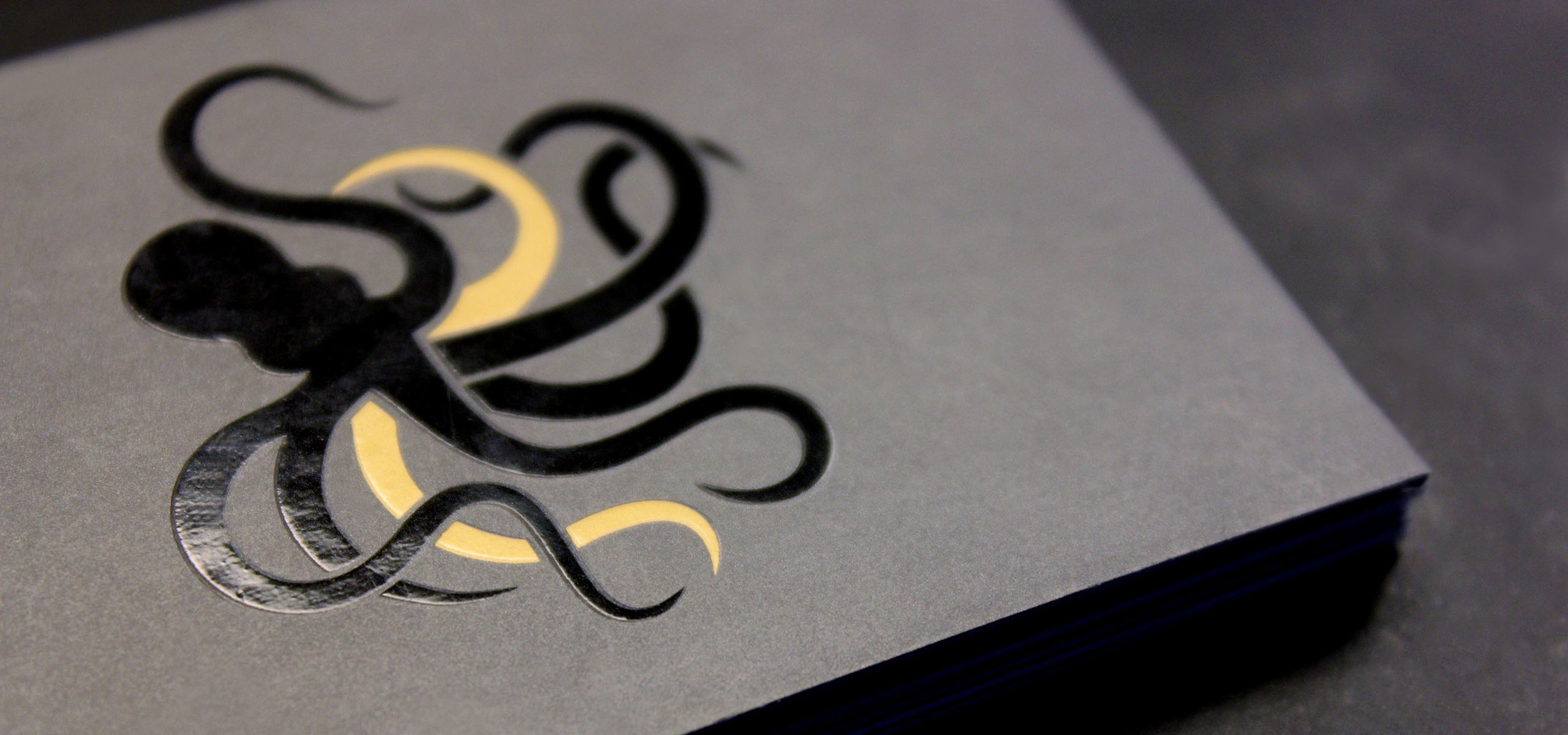 Graphic logo of Kraken Kapital on the backside of business cards as part of stationary design