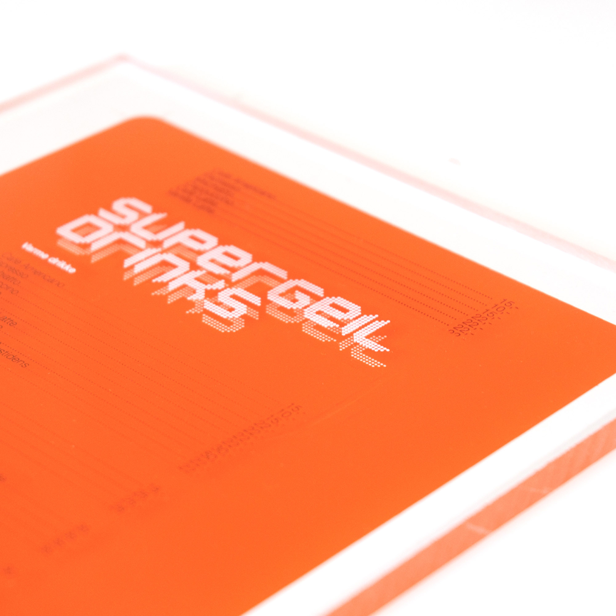 Orange menu card for Supergeil restaurant