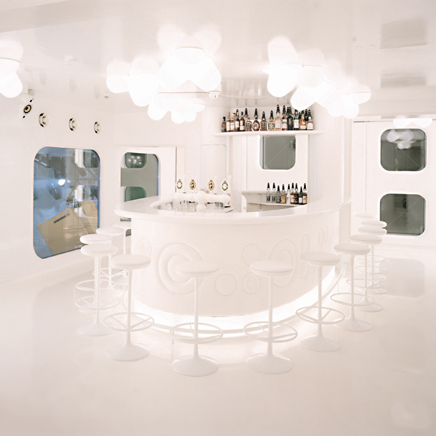 Interior architecture of the white nightclub NASA including lighting and furniture design
