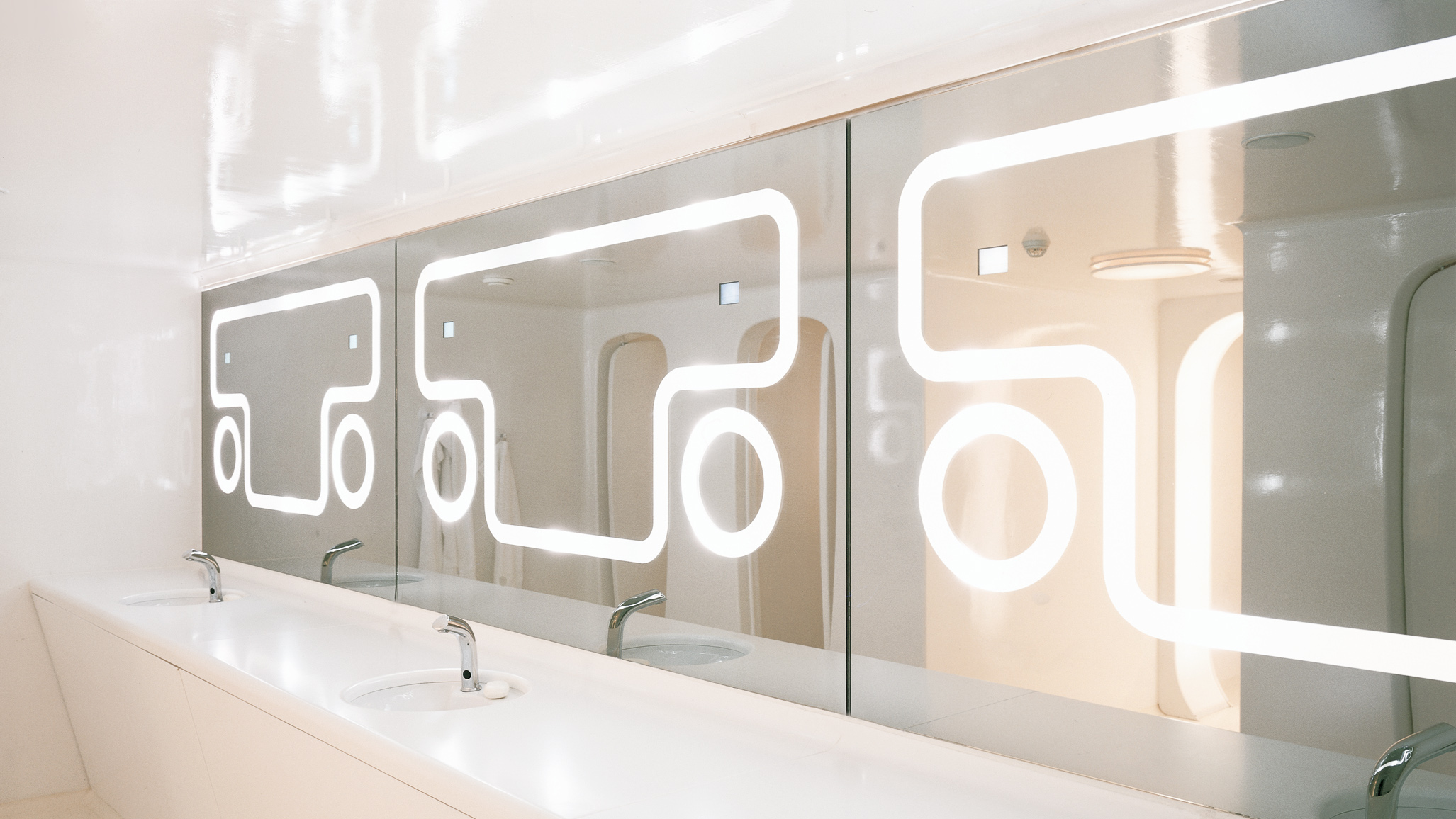Lit mirrors at the restrooms of NASA nightclub representing the bar's visual identity