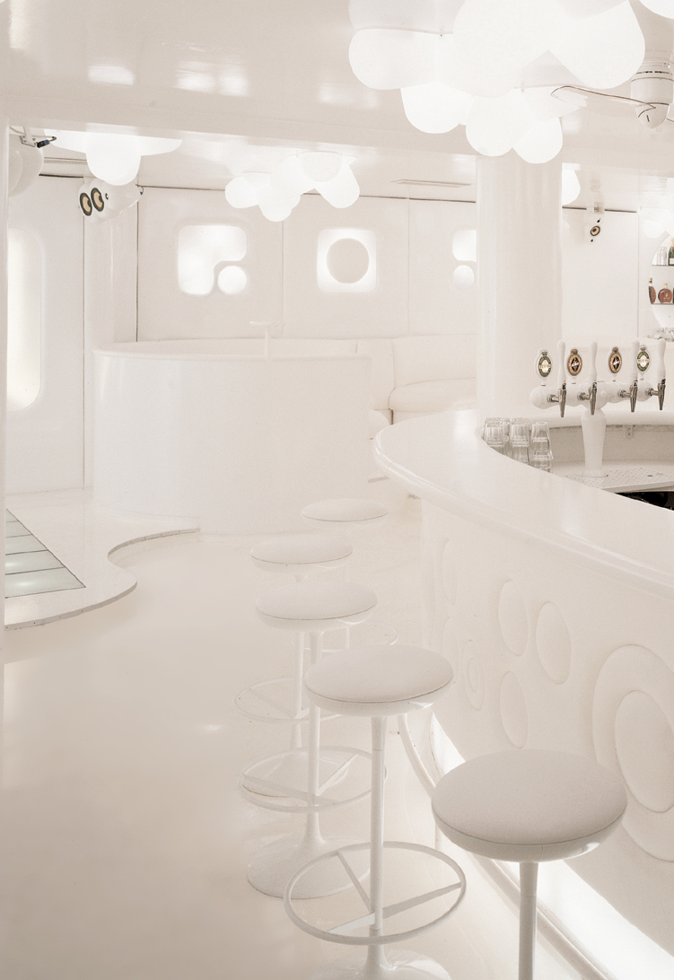 Bar area of NASA Nightclub  decorated by completely white furniture resulting in an elegant and futuristic aesthetic