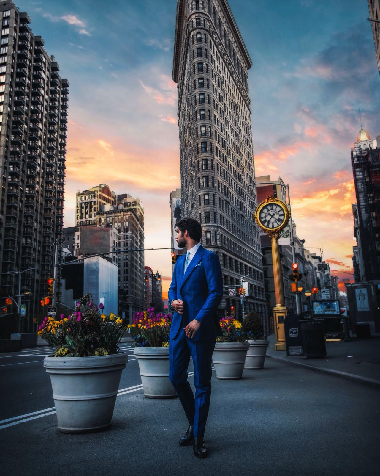 """Marco is wearing a two piece """"the amarcord suit"""" with wide notch lapel, and patch pockets and a little ticket patch pocket. Fabric: wide pinstripe royal blue 130's"""