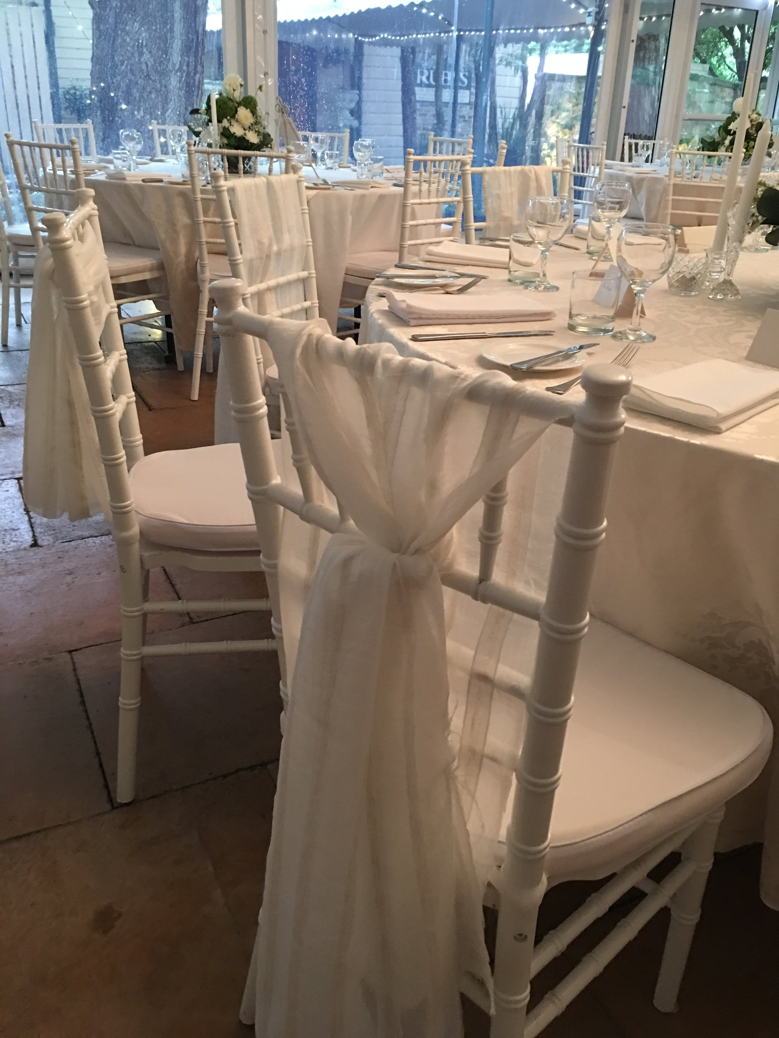 Sheer bone stripe chair ties, white/silver damask tablelcoths and 100% linen white serviettes