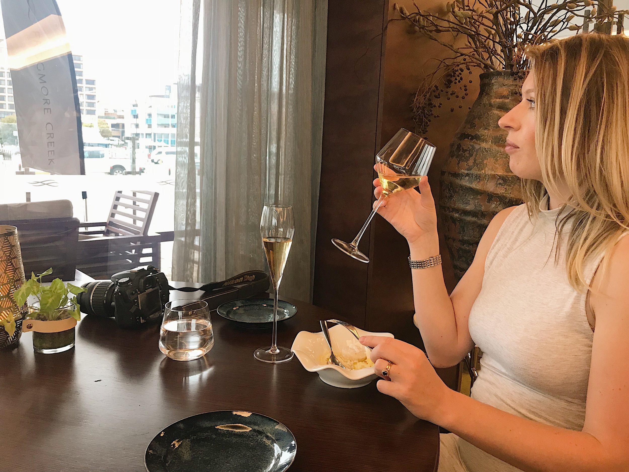 enjoying scallops and matching white wine