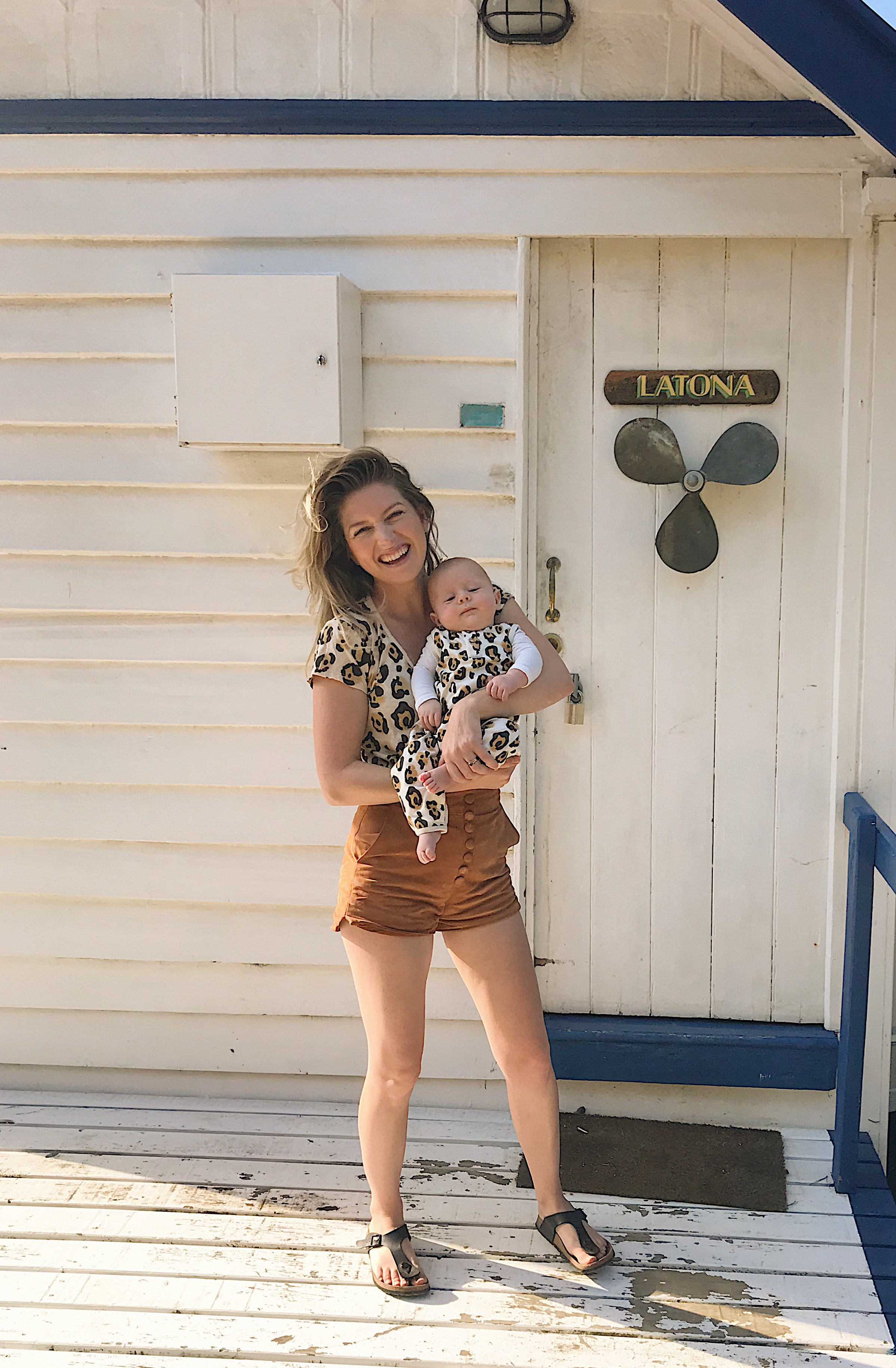 on a boat shed in matching leopard print