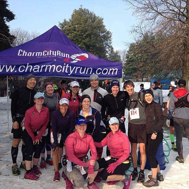 Look at these smiling suckers--our crew from Charm City Run has no idea what's about to hit us! That's me all the way on the right in black (with jacket pockets stuffed full of gels, dates and rice balls), standing next to my husband John. Stupidity is a family affair.    Photo via  Charm City Run