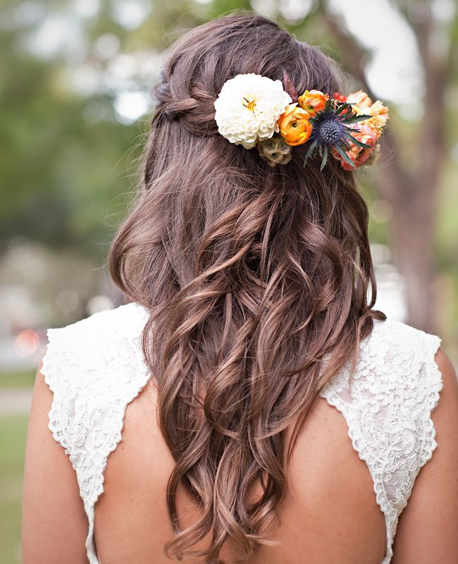 These simple loose curls create this really pretty style, and the flower choices are very suitable for an autumn or spring wedding.