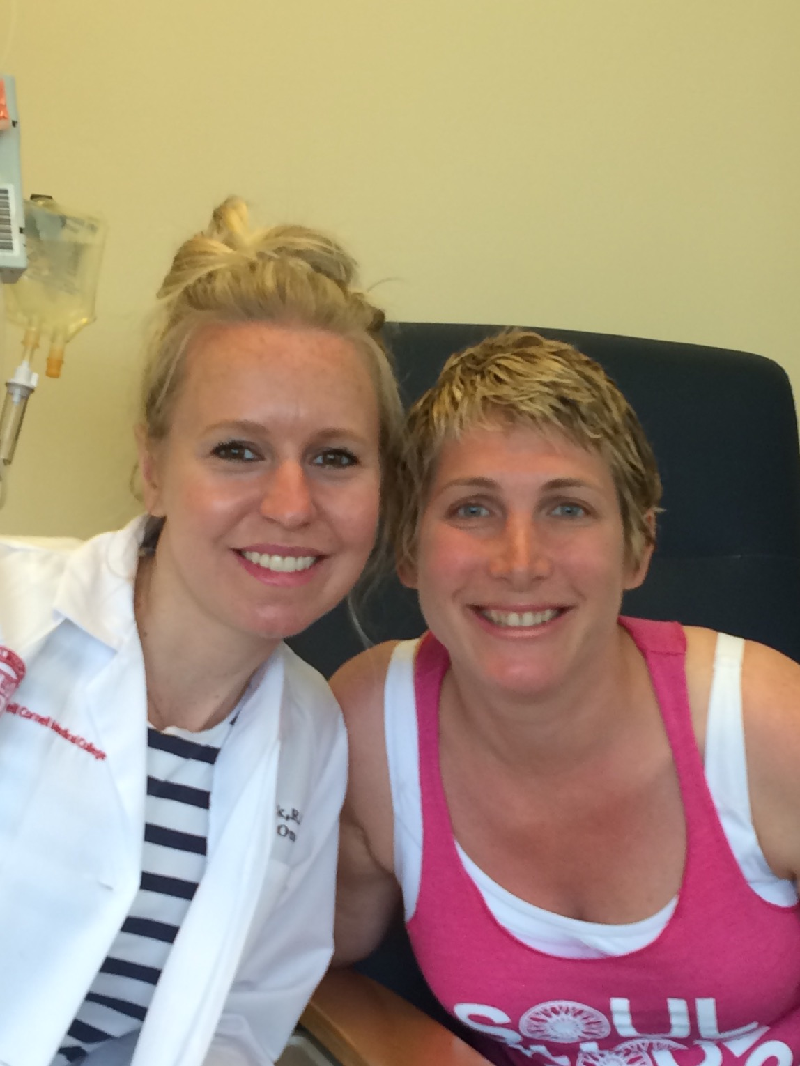 Niko with her nurse during chemotherapy.