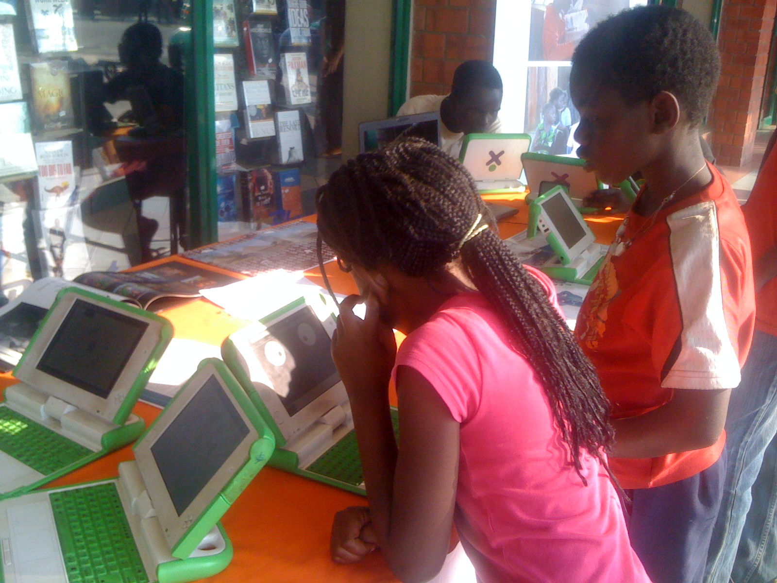 Children at the Lubuto Library Project working with OLPC laptops